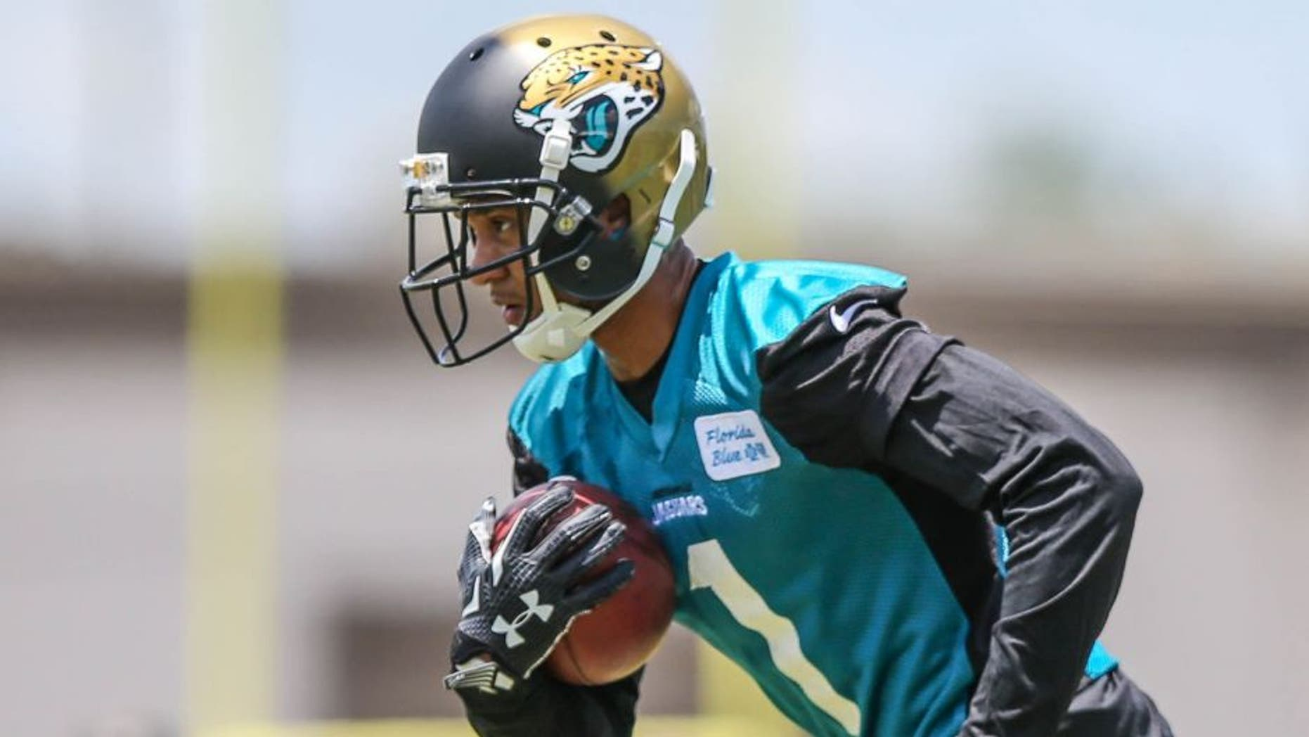 Jacksonville Jaguars wide receiver Rashad Greene (1) carries the ball during drills at NFL football rookie camp Saturday, May 9, 2015, in Jacksonville, Fla. (AP Photo/Gary McCullough)
