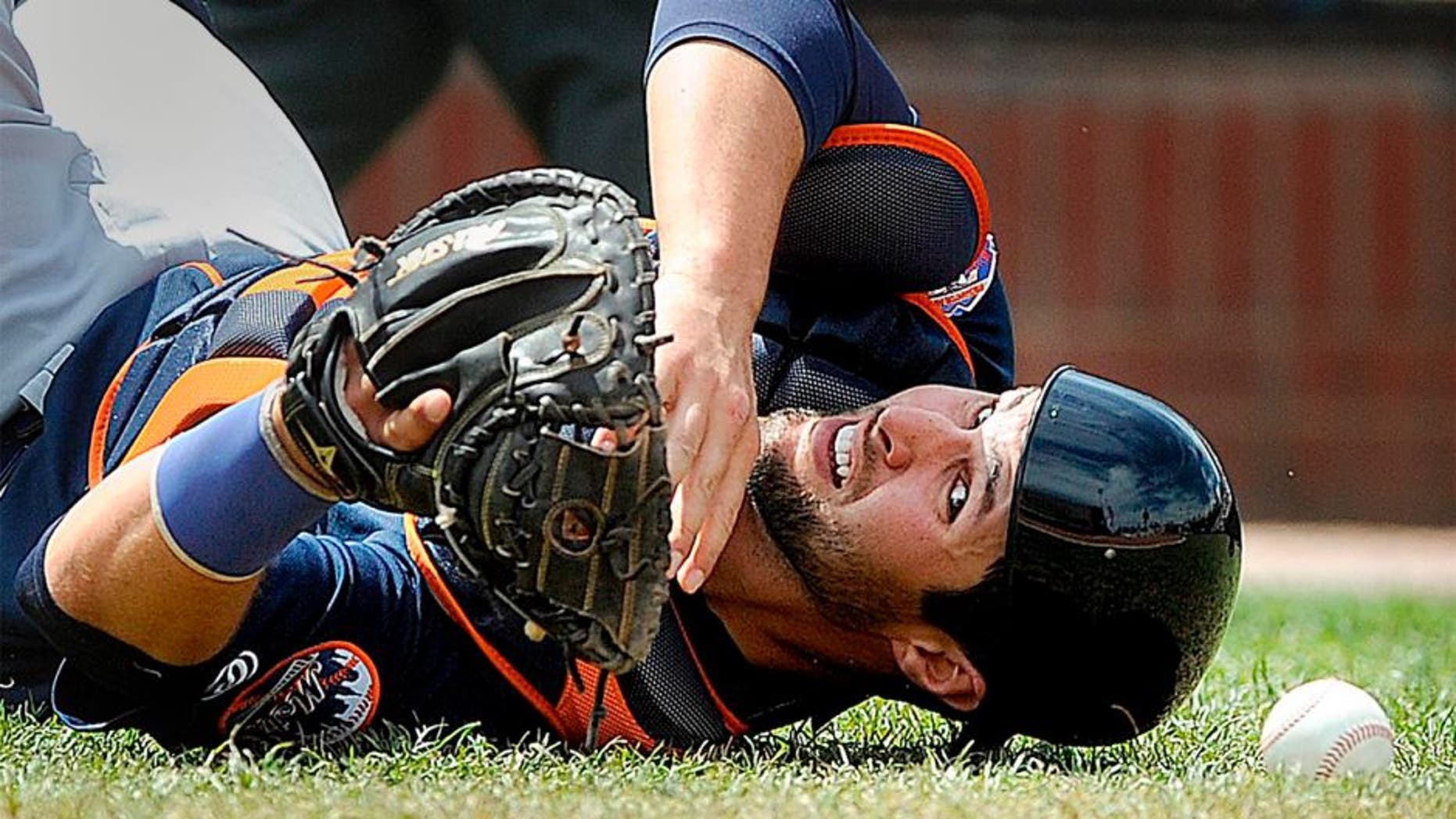 PORTLAND, ME - MAY 14: Colton Plaia of the Binghamton Mets looks back for the baseball after falling to the ground and failing to make a catch on a pop up behind home plate Saturday, May 14, 2016. (Photo by Gabe Souza/Portland Press Herald via Getty Images)