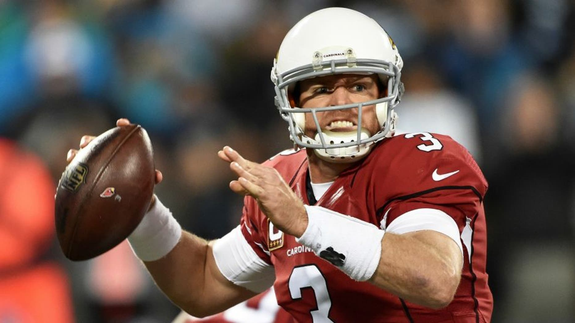 CHARLOTTE, NC - JANUARY 24: Quarterback Carson Palmer #3 of the Arizona Cardinals looks for a receiver during the NFC Championship Game against the Carolina Panthers at Bank of America Stadium on January 24, 2016 in Charlotte, North Carolina. (Photo by Ronald C. Modra/Sports Imagery/Getty Images) *** Local Caption *** Carson Palmer,CHARLOTTE, NC - JANUARY 24: Quarterback Carson Palmer #3 of the Arizona Cardinals looks for a receiver during the NFC Championship Game against the Carolina Panthers at Bank of America Stadium on January 24, 2016 in Charlotte, North Carolina. (Photo by Ronald C. Modra/Sports Imagery/Getty Images)