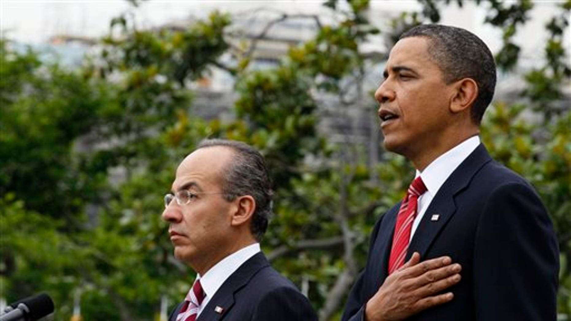 President Obama stands with Mexican President Felipe Calderon during the playing of the American National Anthem, on the South Lawn of the White House in Washington, Wednesday, May 19, 2010. President Calderon will be attending a state dinner at the White House with President Obama later in the evening (AP).