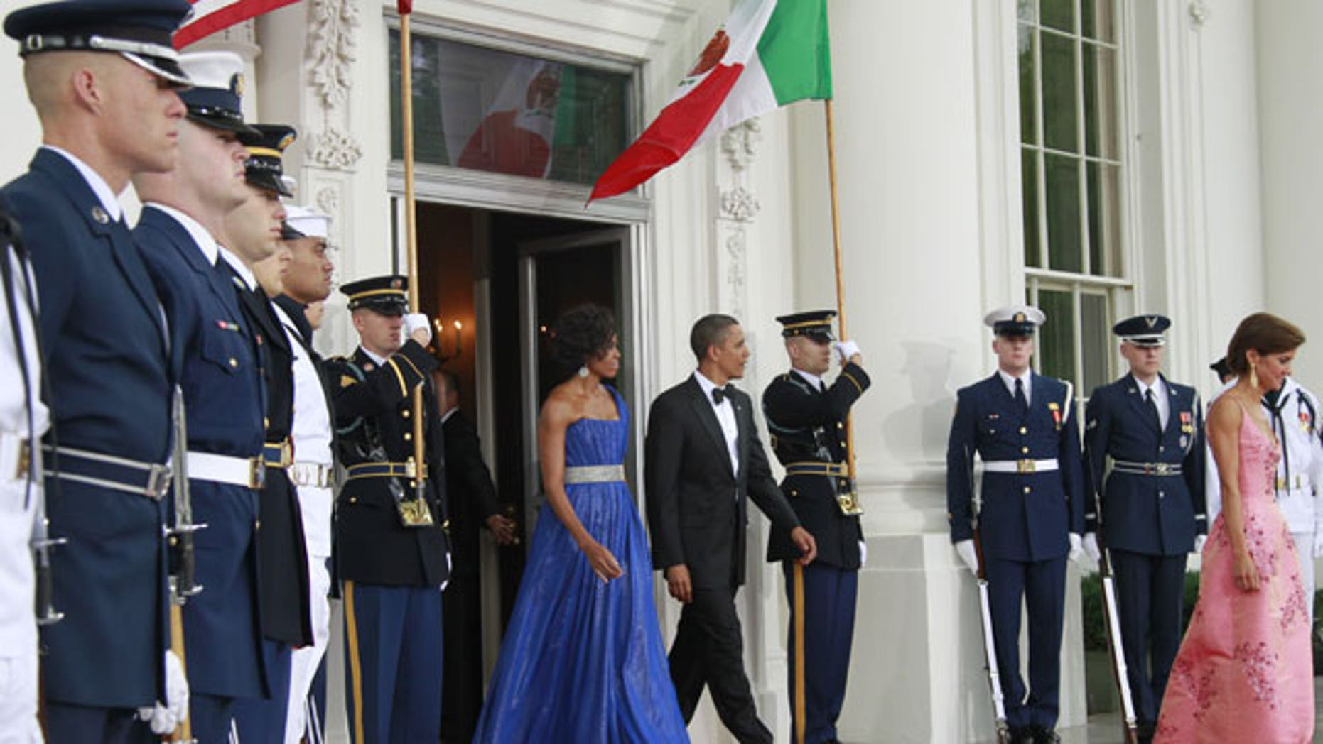 May 19: President Obama and first lady Michelle Obama walk out on the North Portico of the White House to welcome Mexican President Felipe Calderon and Mexico's first lady Margarita Zavala for the State Dinner at the White House in Washington.