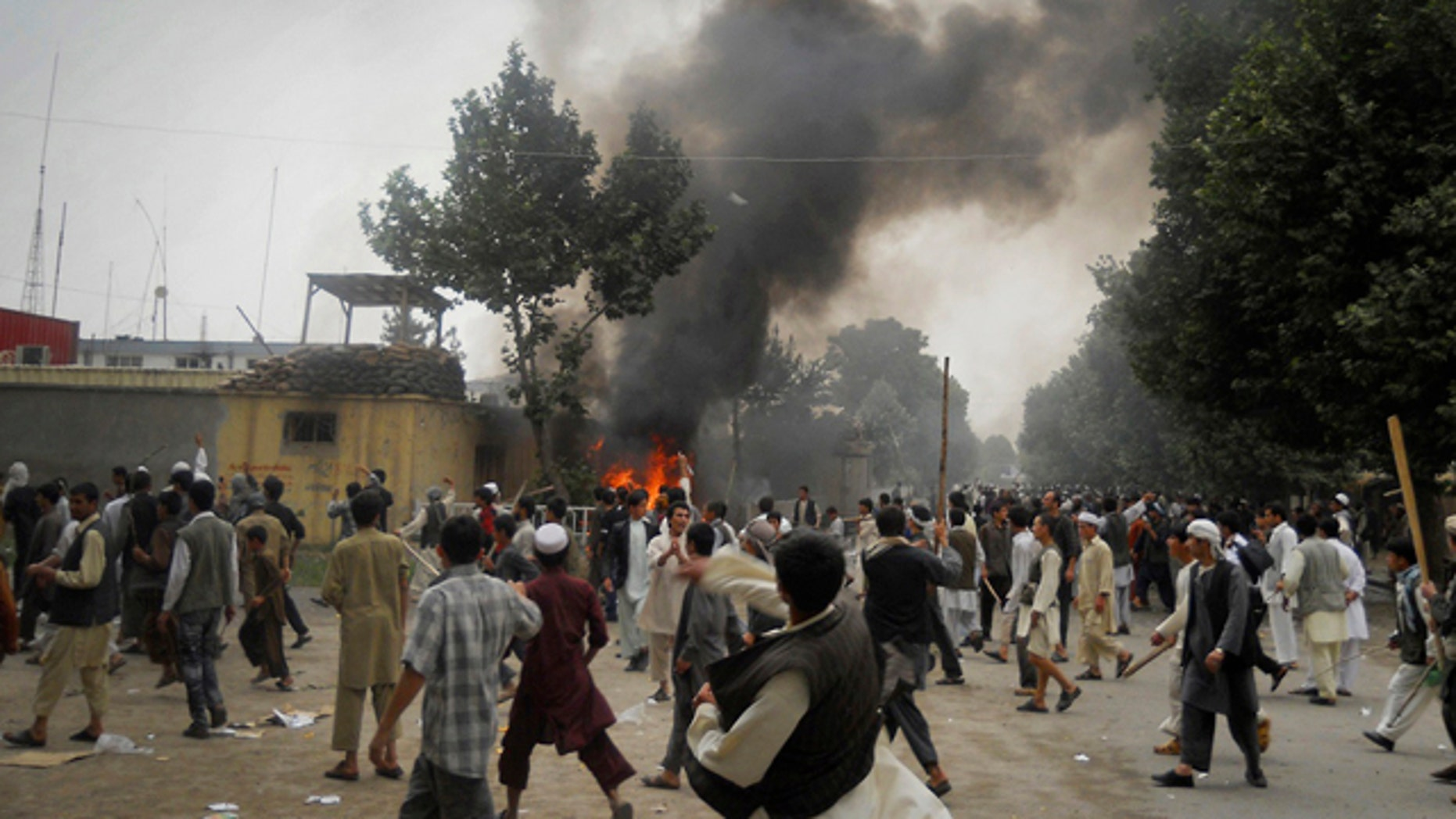 May 19: Smoke rises after protesters set alight police motorcycles at a police headquarter compound during a demonstration in Taloqan, Takhar province, north of Kabul, Afghanistan.