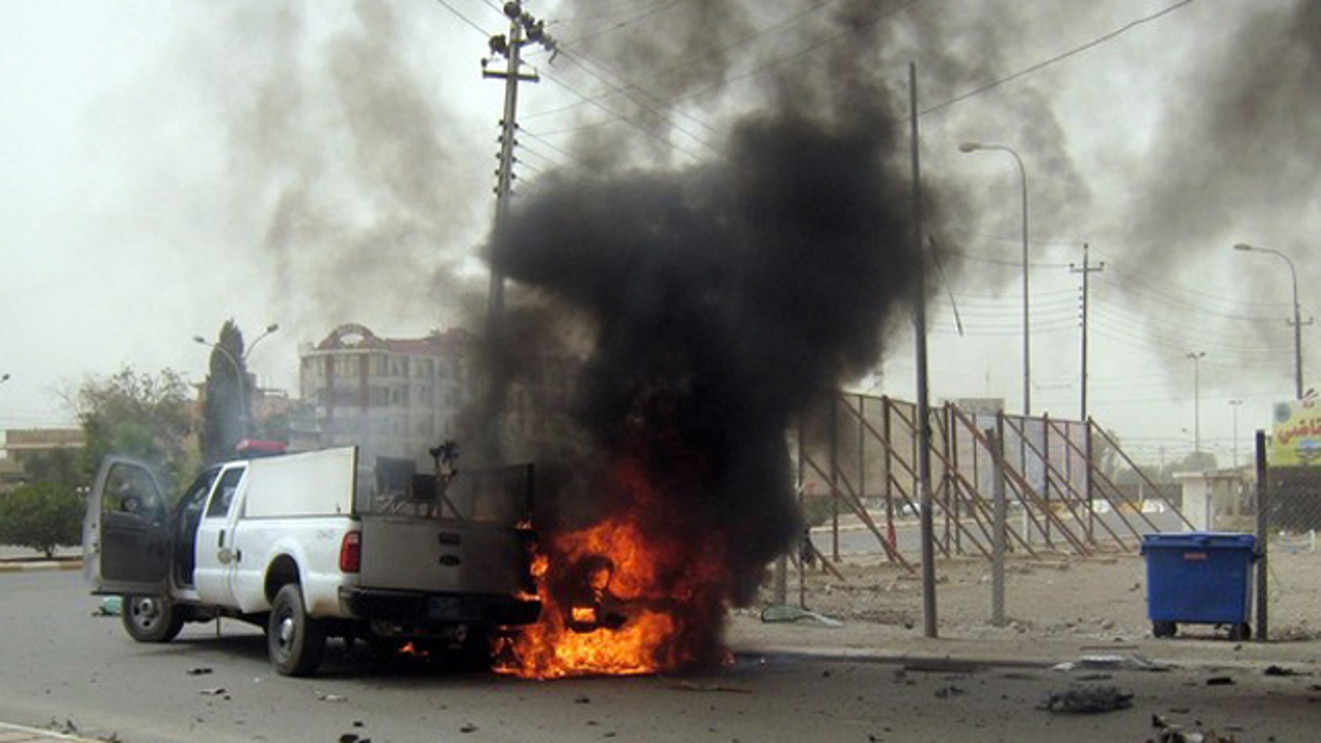 May 19: A car burns following a bomb attack in the northern oil-rich city of Kirkuk, killing at least 27 people.