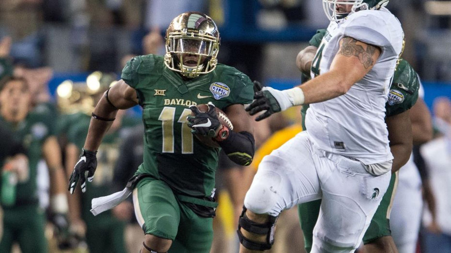 Jan 1, 2015; Arlington, TX, USA; Baylor Bears linebacker Taylor Young (11) returns an interception during the second half against the Michigan State Spartans in the 2015 Cotton Bowl Classic at AT&T Stadium. Young is named the defensive MVP. The Spartans defeated the Bears 42-41. Mandatory Credit: Jerome Miron-USA TODAY Sports
