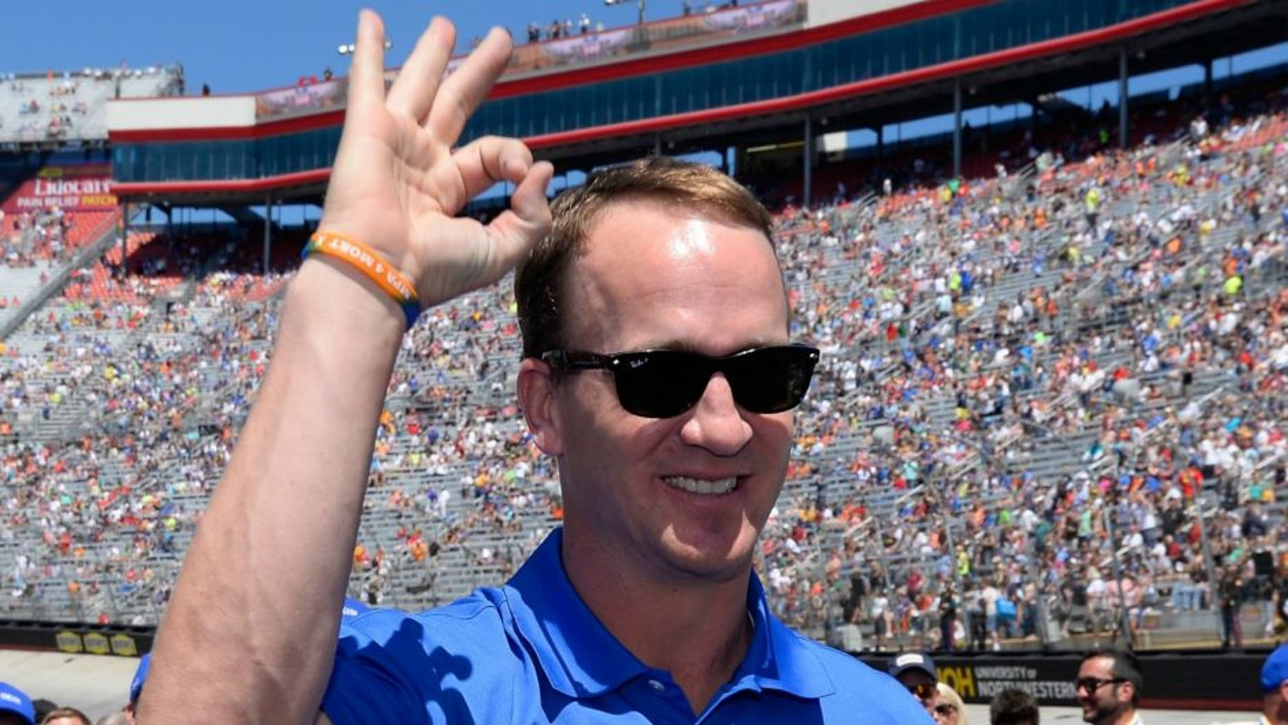 during the NASCAR Sprint Cup Series Food City 500 at Bristol Motor Speedway on April 17, 2016 in Bristol, Tennessee.,BRISTOL, TN - APRIL 17: Former NFL quarterback, Peyton Manning stands on the grid prior to the NASCAR Sprint Cup Series Food City 500 at Bristol Motor Speedway on April 17, 2016 in Bristol, Tennessee. (Photo by Robert Laberge/Getty Images)