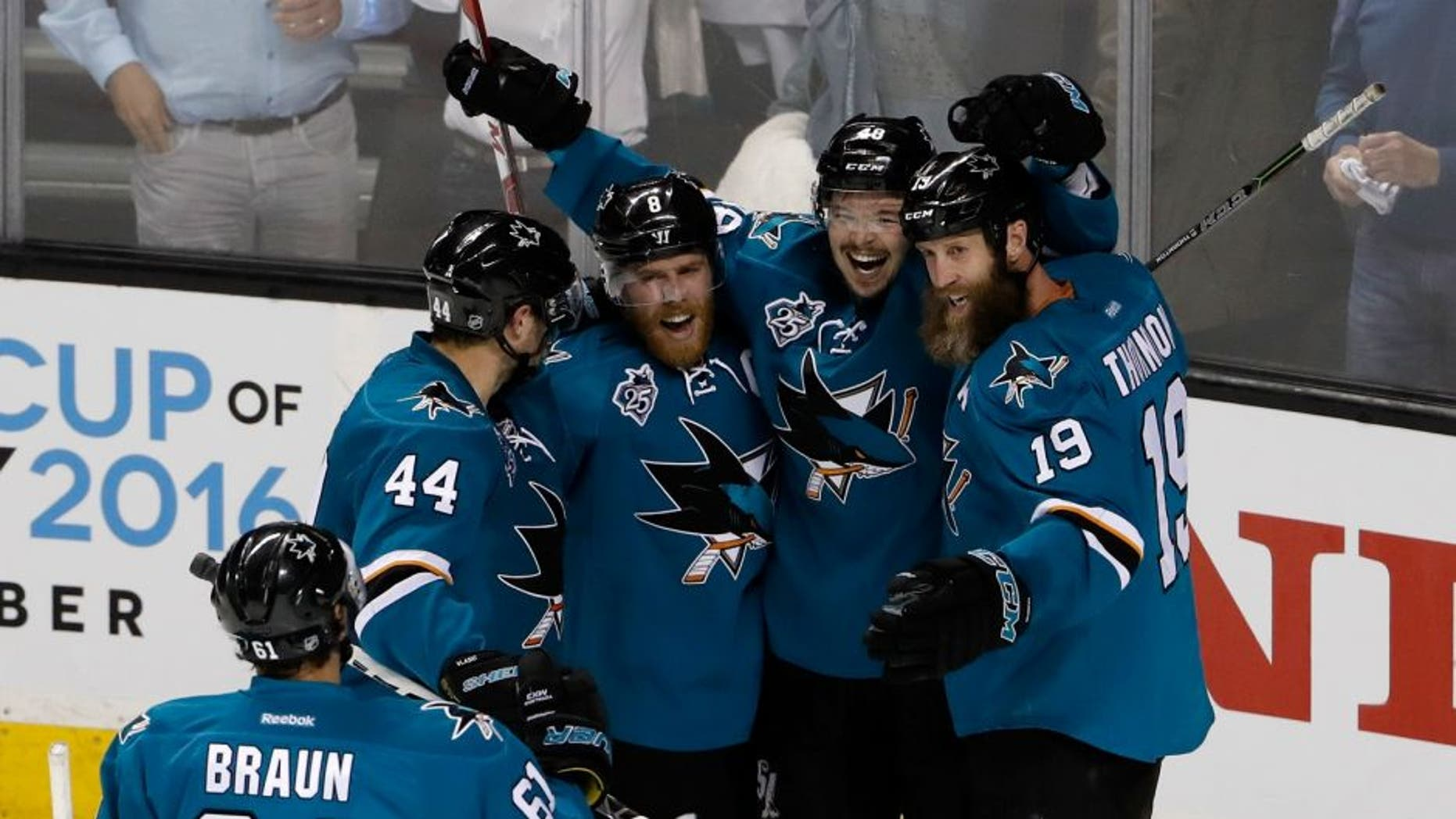 SAN JOSE, CA - MAY 19: (2nd R) Tomas Hertl #48 of the San Jose Sharks celebrates with Justin Braun #61, Marc-Edouard Vlasic #44, Joe Pavelski #8 and Joe Thornton #19 after his second goal in game three of the Western Conference Finals against the St. Louis Blues during the 2016 NHL Stanley Cup Playoffs at SAP Center on May 19, 2016 in San Jose, California. (Photo by Christian Petersen/Getty Images)