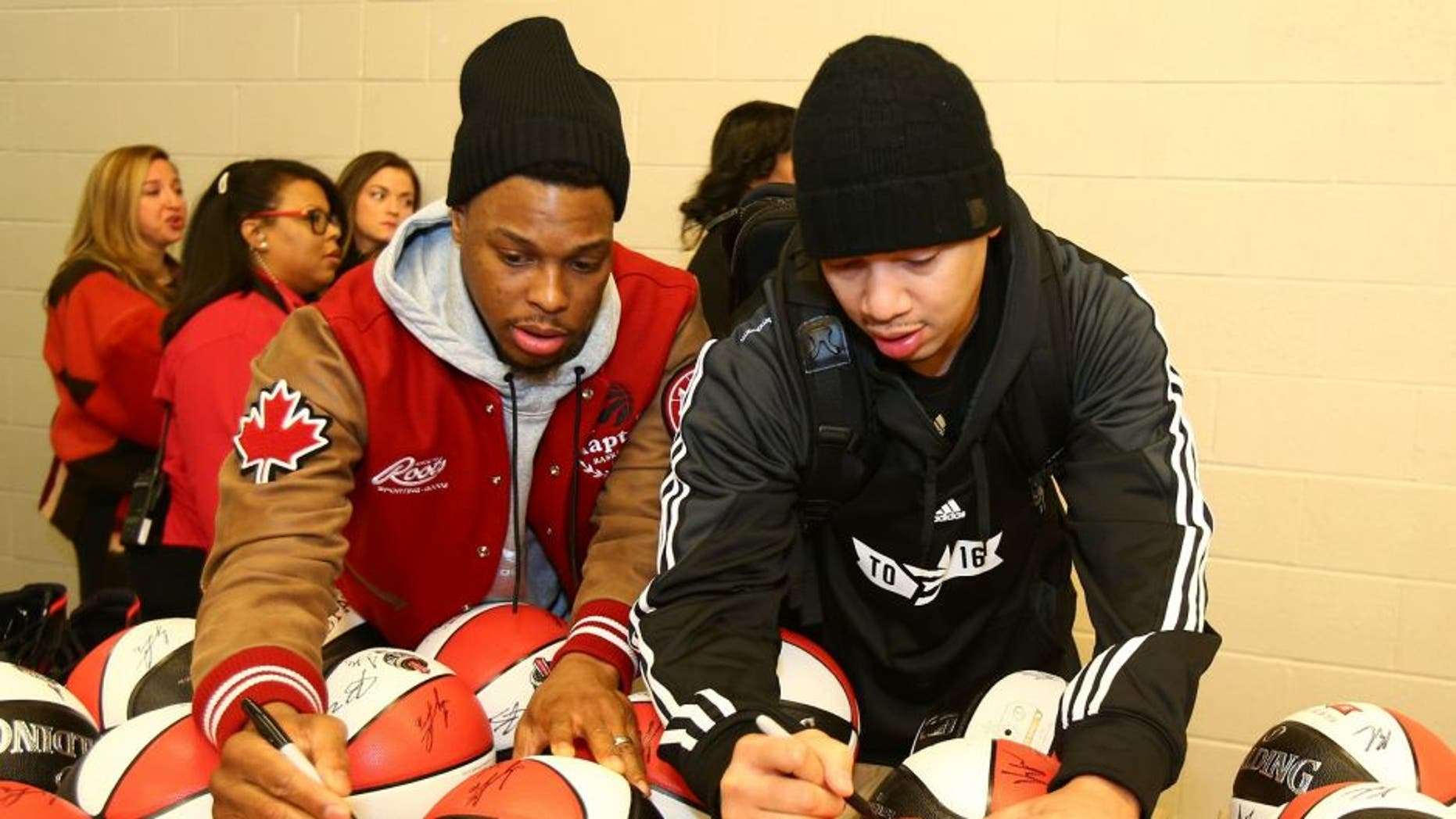 TORONTO, CANADA - FEBRUARY 13: Kyle Lowry #7 and Tyronn Lue of the Eastern Conference All-Stars autographs balls before the NBA All-Star Practice as part of 2016 All-Star Weekend at the Ricoh Coliseum on February 13, 2016 in Toronto, Ontario, Canada. NOTE TO USER: User expressly acknowledges and agrees that, by downloading and/or using this photograph, user is consenting to the terms and conditions of the Getty Images License Agreement. Mandatory Copyright Notice: Copyright 2016 NBAE (Photo by Nathaniel S. Butler/NBAE via Getty Images)