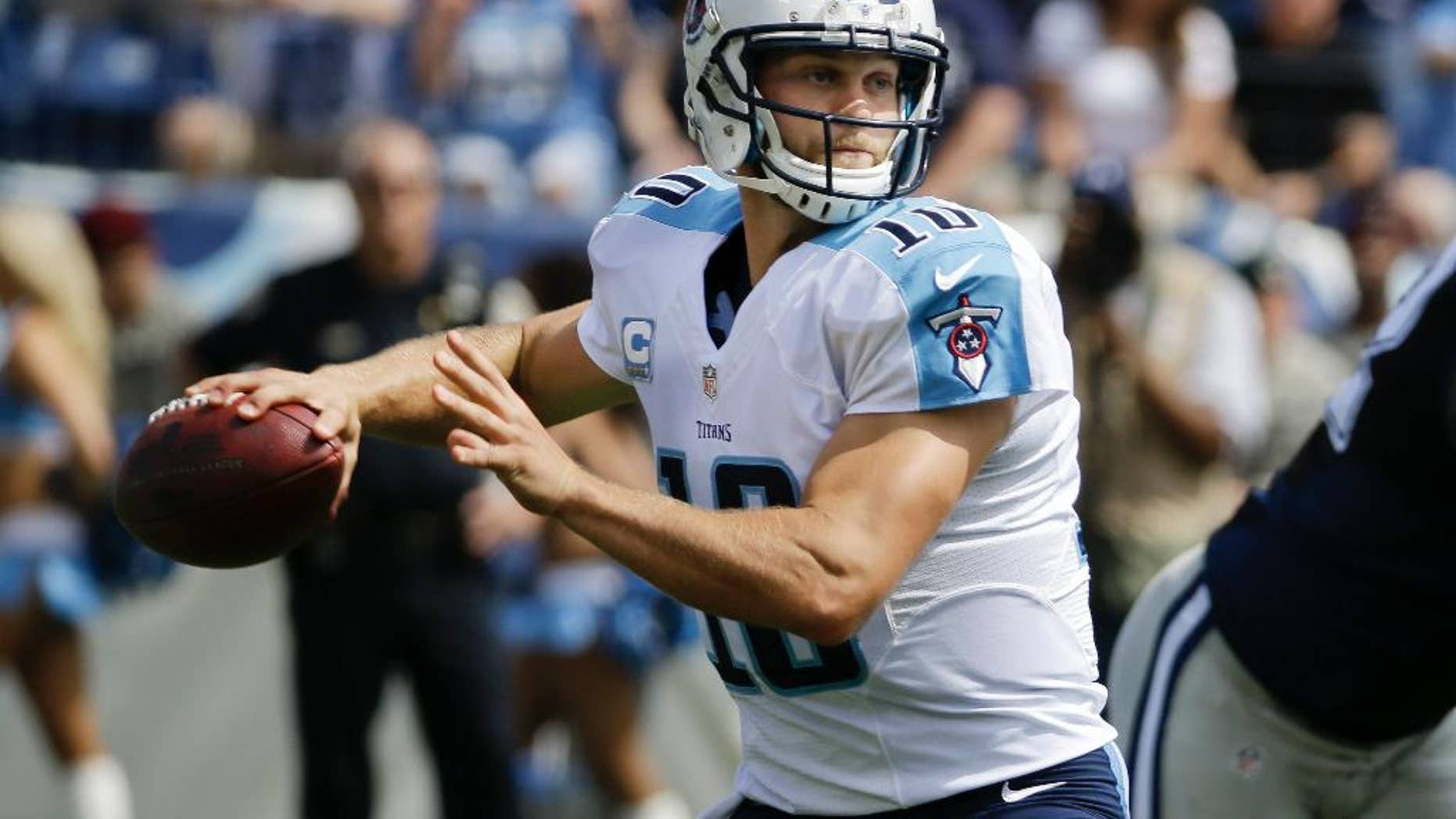 FILE - In this Sept. 14, 2014, file photo, Tennessee Titans quarterback Jake Locker (10) passes against the Dallas Cowboys in the first quarter of an NFL football game in Nashville, Tenn. Locker appears to be ready to return to the starting lineup for Tennessee after missing a game with his injured right wrist.  (AP Photo/Wade Payne, File)