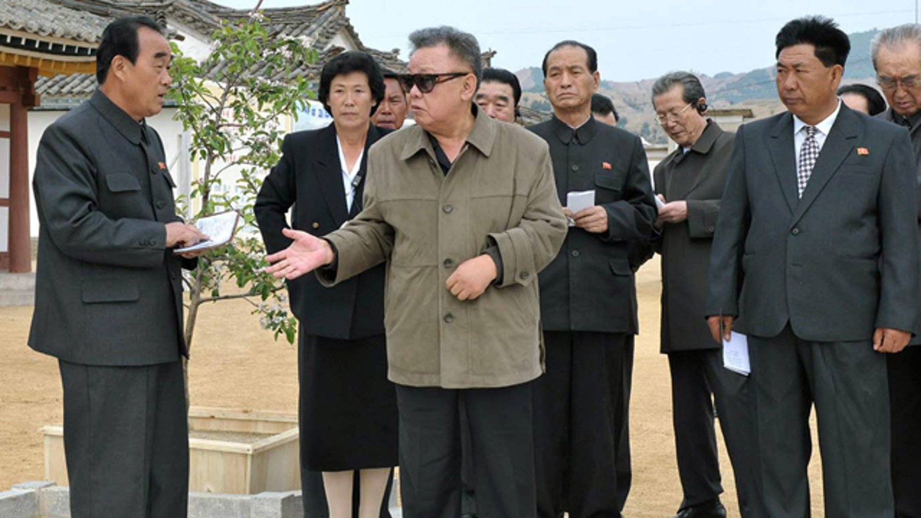 May 19: North Korean leader Kim Jong Il, center, inspects the Toksong fruit farm in South Hamgyong Province, North Korea.