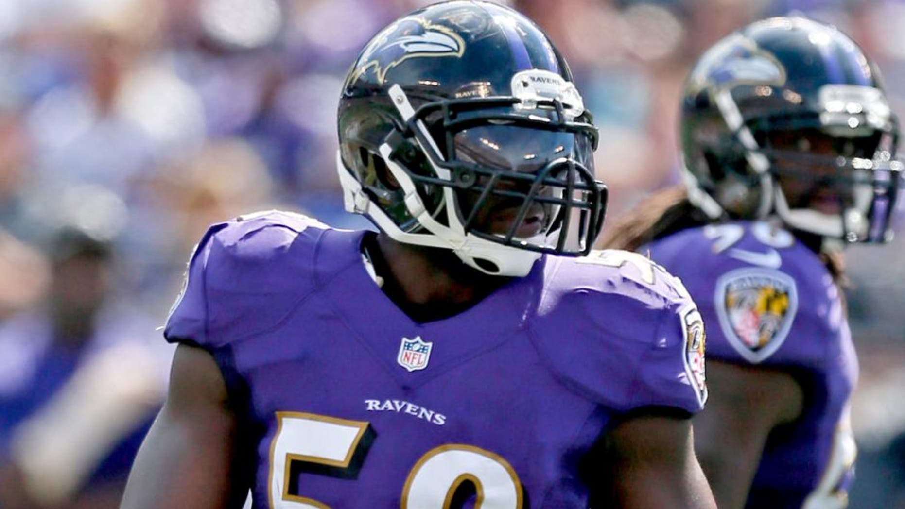 Sep 15, 2013; Baltimore, MD, USA; Baltimore Ravens linebacker Elvis Dumervil (58) during the game against the Cleveland Browns at M&T Bank Stadium. Mandatory Credit: Mitch Stringer-USA TODAY Sports