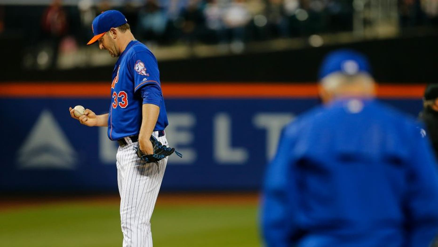 NEW YORK, NY - MAY 19: Pitcher Matt Harvey #33 of the New York Mets stares at the ball as manager Terry Collins #10 comes out to relieve him during the third inning of a game at Citi Field on May 19, 2016 in the Flushing neighborhood of the Queens borough of New York City. (Photo by Rich Schultz/Getty Images)