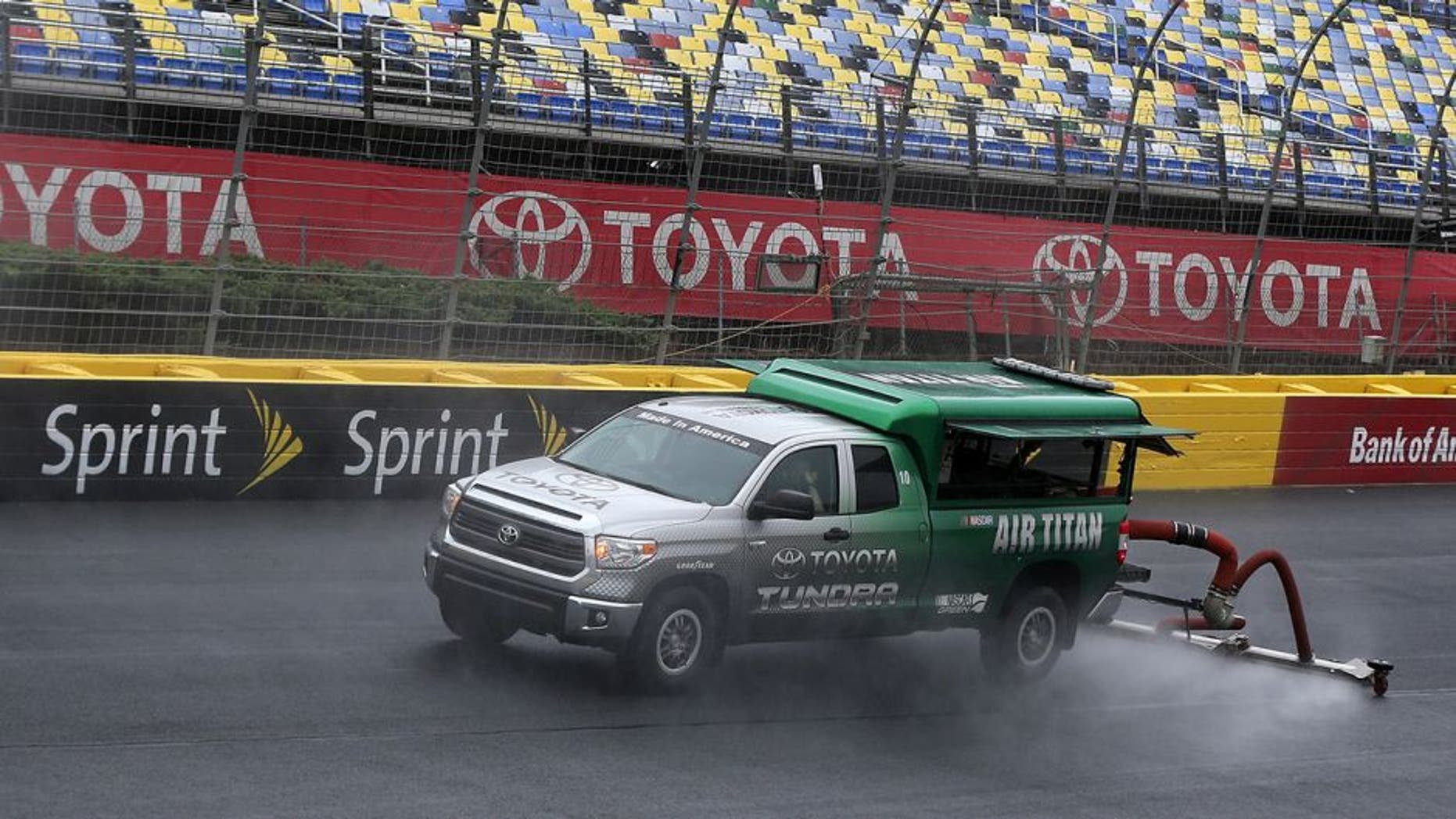 CHARLOTTE, NC - MAY 19: An Air Titan 2.0 works to dry the track prior to practice for the NASCAR Camping World Truck Series North Carolina Education Lottery 200 at Charlotte Motor Speedway on May 19, 2016 in Charlotte, North Carolina. (Photo by Matt Sullivan/NASCAR via Getty Images)