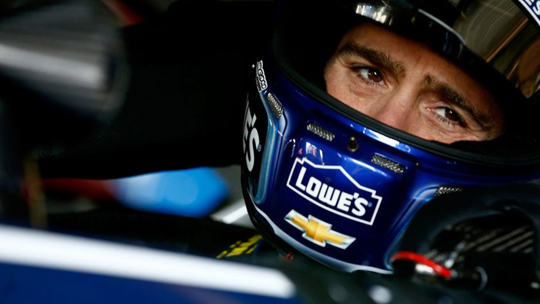 DOVER, DE - MAY 14: Jimmie Johnson, driver of the #48 Lowe's Chevrolet, sits in his car during practice for the NASCAR Sprint Cup Series AAA Drive For Autism at Dover International Speedway on May 14, 2016 in Dover, Delaware. (Photo by Jeff Zelevansky/NASCAR via Getty Images)