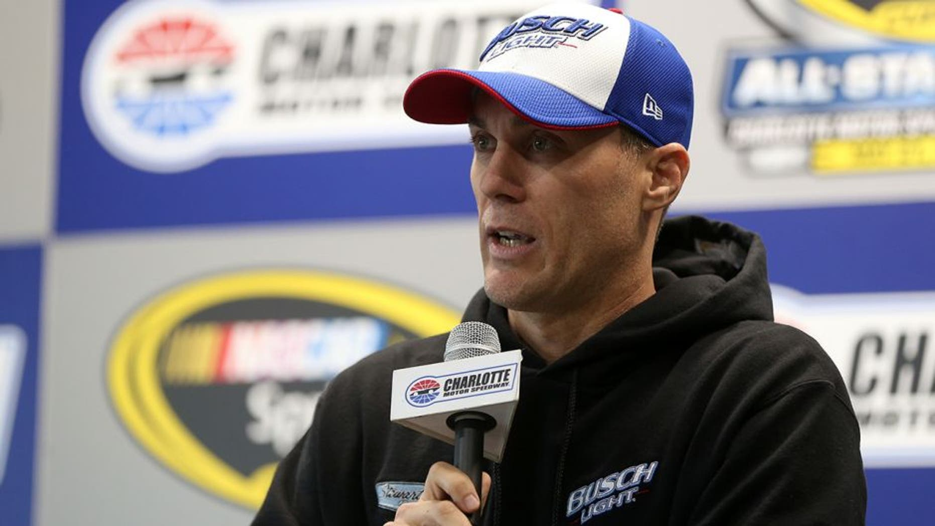 CHARLOTTE, NC - MAY 20: Kevin Harvick, driver of the #4 Busch Light Chevrolet, spesks to the media during a press conference prior to practice for the NASCAR Sprint Cup Series Sprint Showdown at Charlotte Motor Speedway on May 20, 2016 in Charlotte, North Carolina. (Photo by Matt Sullivan/NASCAR via Getty Images)