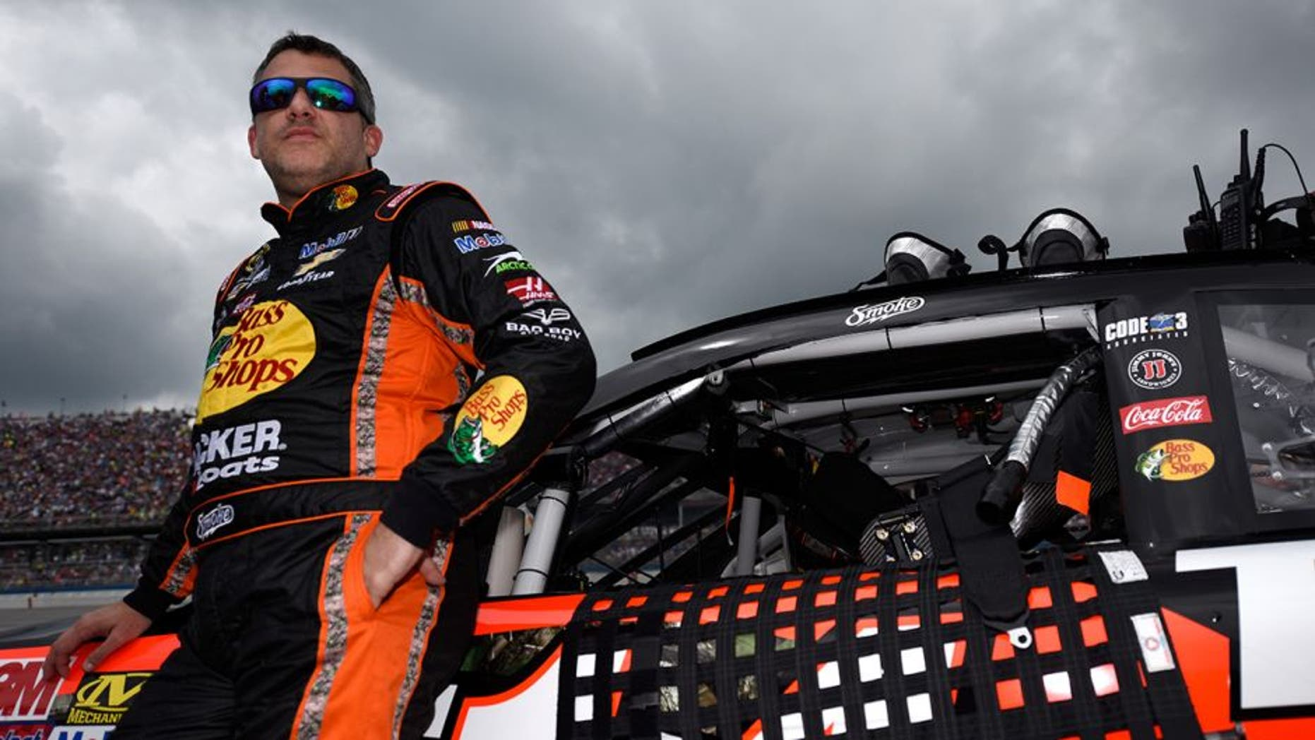 TALLADEGA, AL - MAY 01: Tony Stewart, driver of the #14 Bass Pro Shops Chevrolet, stands on the grid prior to the NASCAR Sprint Cup Series GEICO 500 at Talladega Superspeedway on May 1, 2016 in Talladega, Alabama. (Photo by Jared C. Tilton/Getty Images)