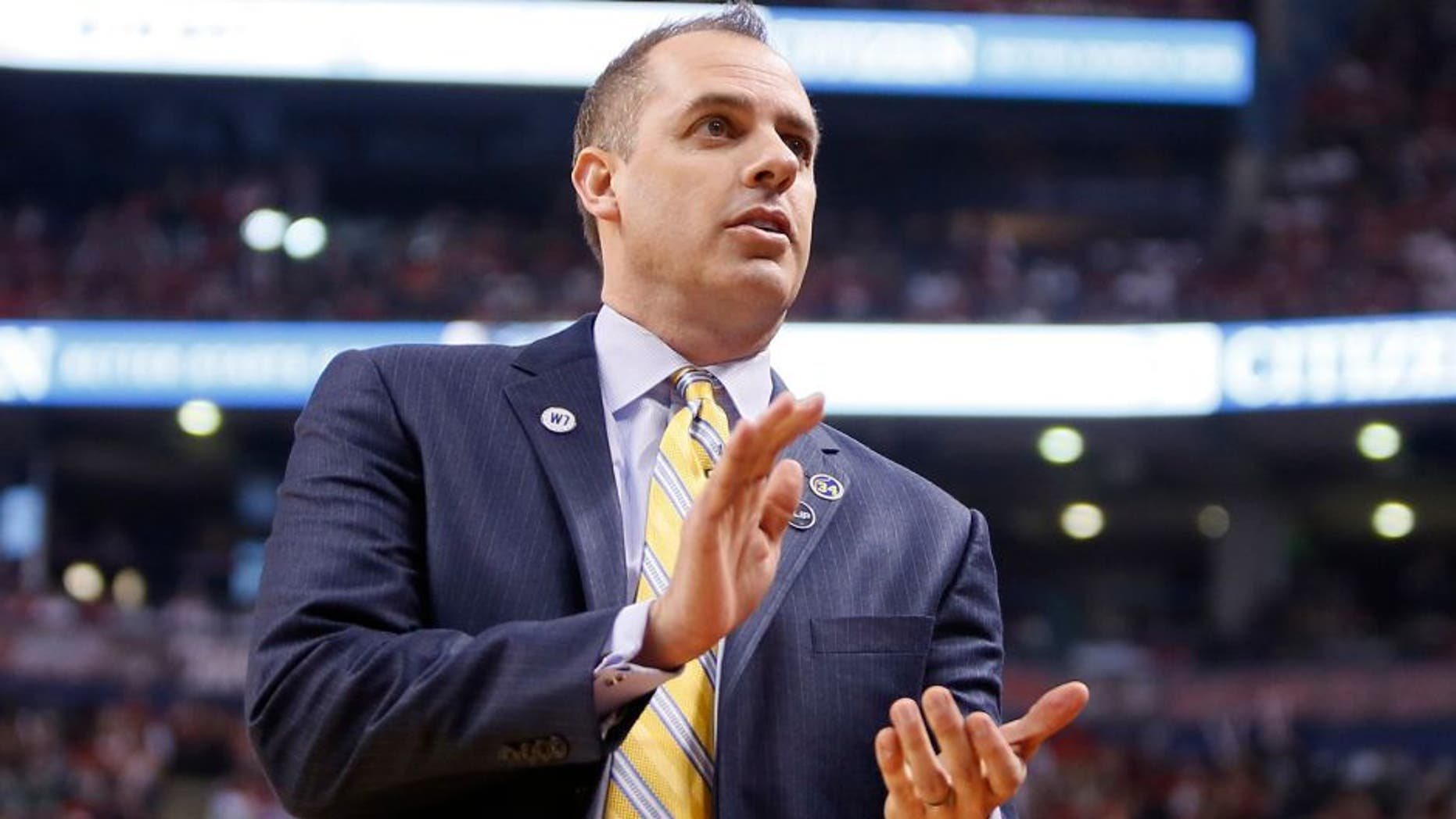Apr 16, 2016; Toronto, Ontario, CAN; Indiana Pacers head coach Frank Vogel reacts in game one of the first round of the 2016 NBA Playoffs against the Toronto Raptors at Air Canada Centre. Indiana defeated Toronto 100-90. Mandatory Credit: John E. Sokolowski-USA TODAY Sports