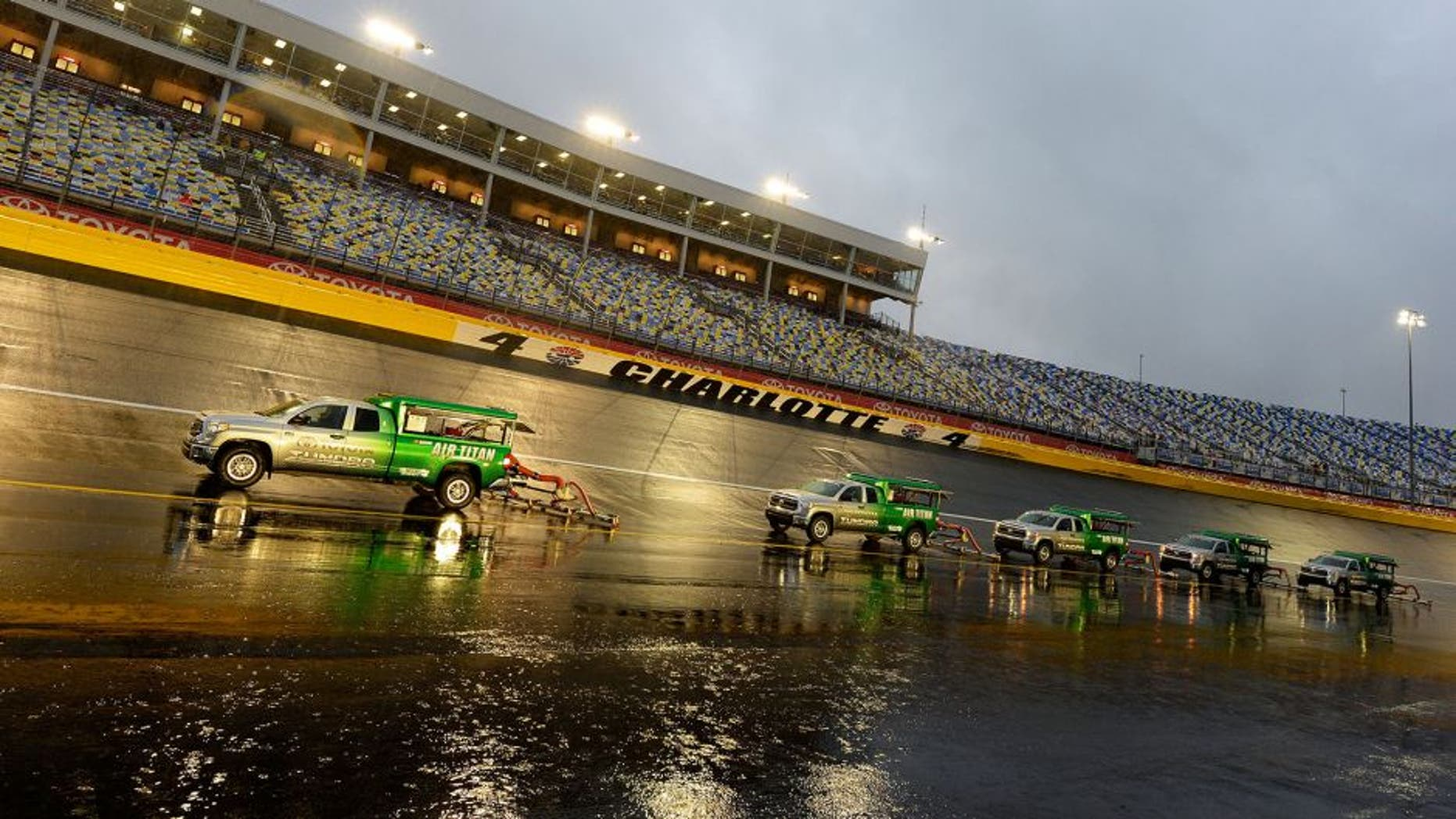 CHARLOTTE, NC - OCTOBER 10: Air-titans sit ready during a rain delay for the NASCAR Sprint Cup Series Bank of America 500 at Charlotte Motor Speedway on October 10, 2015 in Charlotte, North Carolina. (Photo by Robert Laberge/Getty Images)