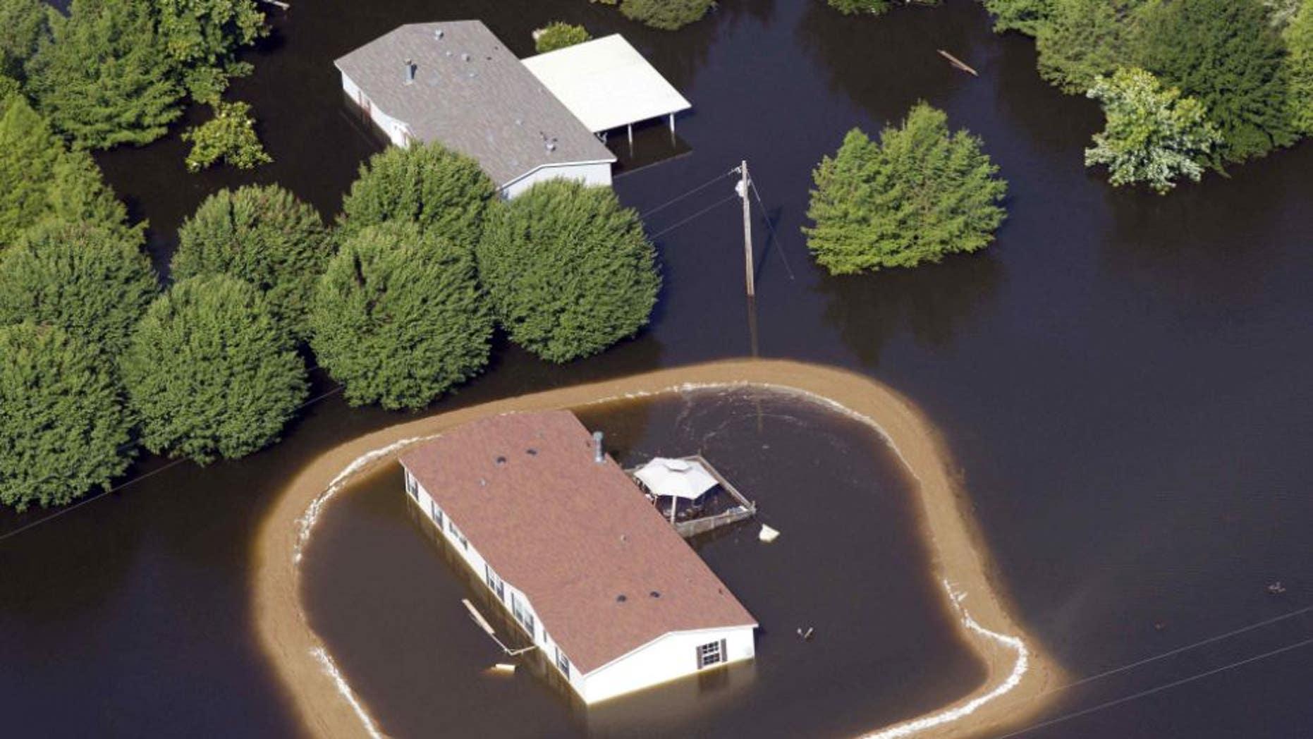 Dam built around house in Mississippi