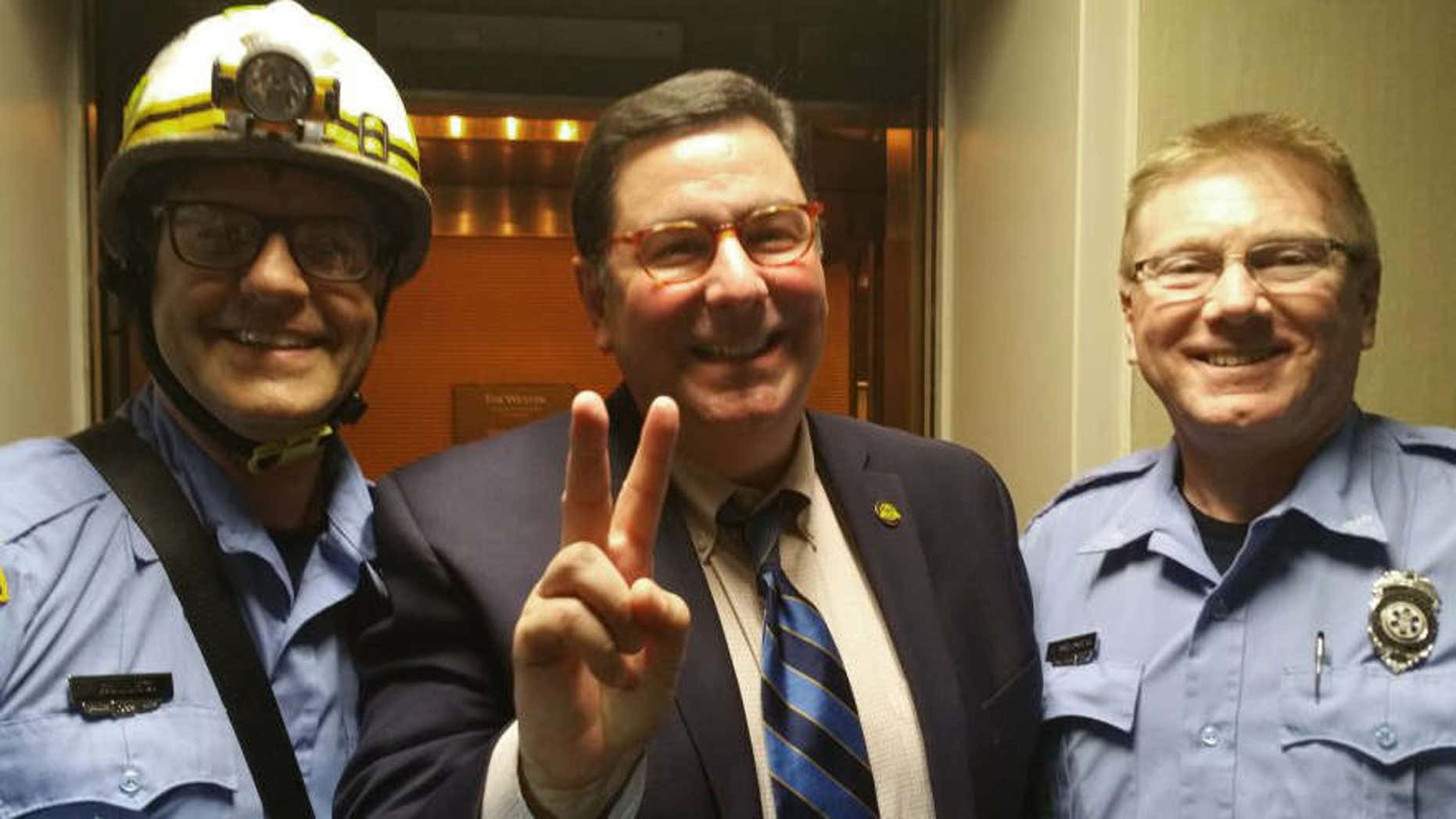 This photo provided by Pittsburgh Mayor Bill Peduto on Thursday, May 19, 2016 shows Peduto posing with two paramedics in Pittsburgh.
