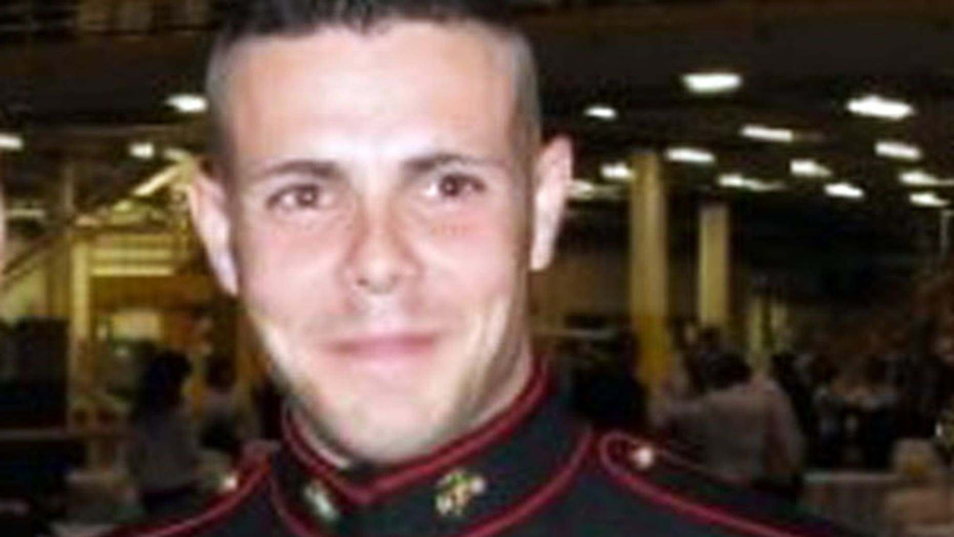 An undated photo of Jesse Bernard Johnston III, 26, wearing a Marine dress uniform with ribbons and medals -- even though records show he never served in the Marine Corps. Despite not having a military background, Johnston was able to join the Army Reserve in February and was given the rank of sergeant.