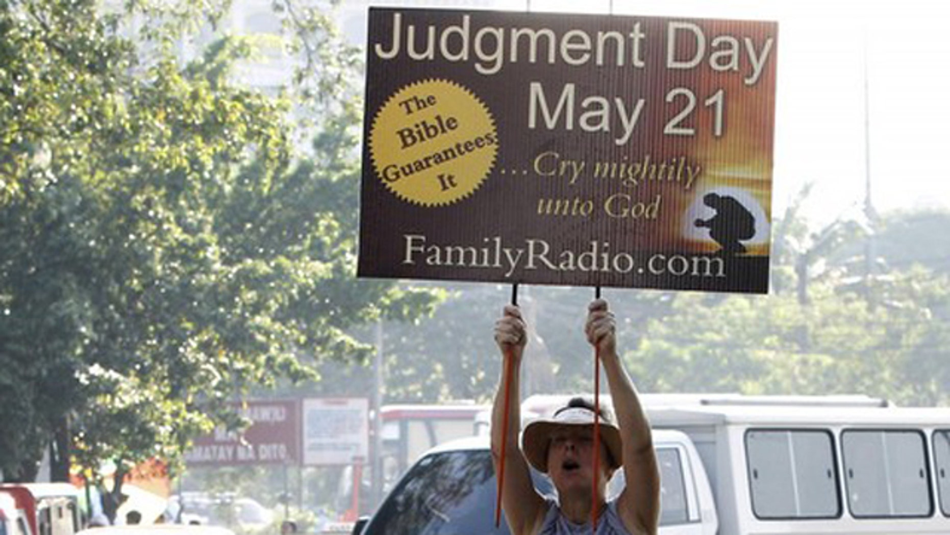 May 13: Debra Schaper of Maryland, who is a member of a religious group called Family Radio, displays a placard while spreading the group's prediction that the world will end on May 21, 2011.