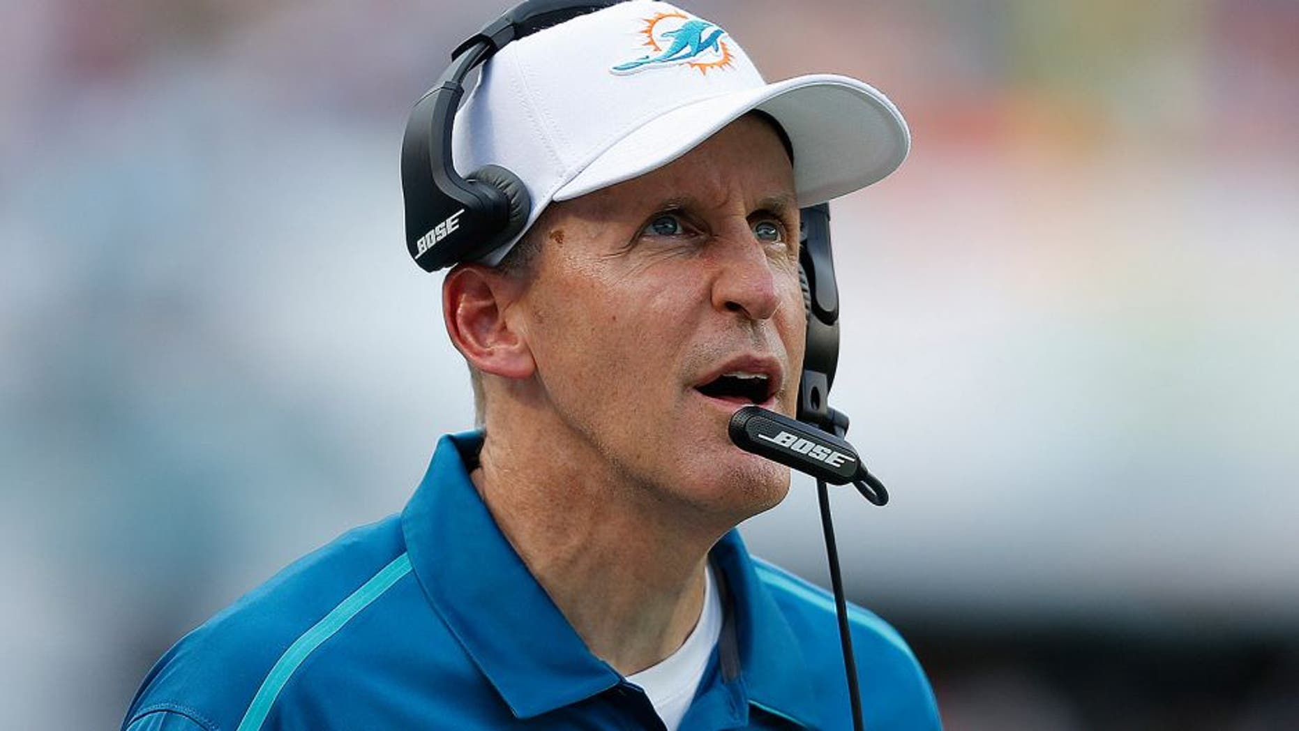MIAMI GARDENS, FL - DECEMBER 21: Head coach Joe Philbin of the Miami Dolphins watches a replay during fourth quarter action against the Minnesota Vikings on December 21, 2014 at Sun Life Stadium in Miami Gardens, Florida. The Dolphins defeated the Vikings 37-35. (Photo by Joel Auerbach/Getty Images)