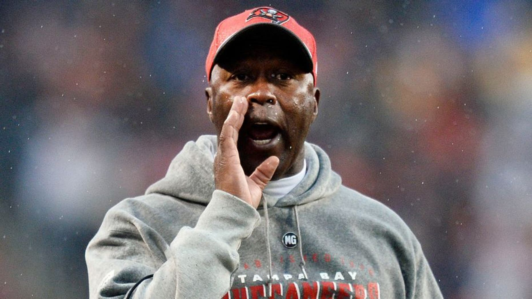 CHICAGO, IL - NOVEMBER 23: Head coach Lovie Smith of the Tampa Bay Buccaneers yells during the fourth quarter against the Chicago Bears on November 23, 2014 at Soldier Field in Chicago, Illinois. The Bears defeated the Buccaneers 21-13. (Photo by Brian Kersey/Getty Images)