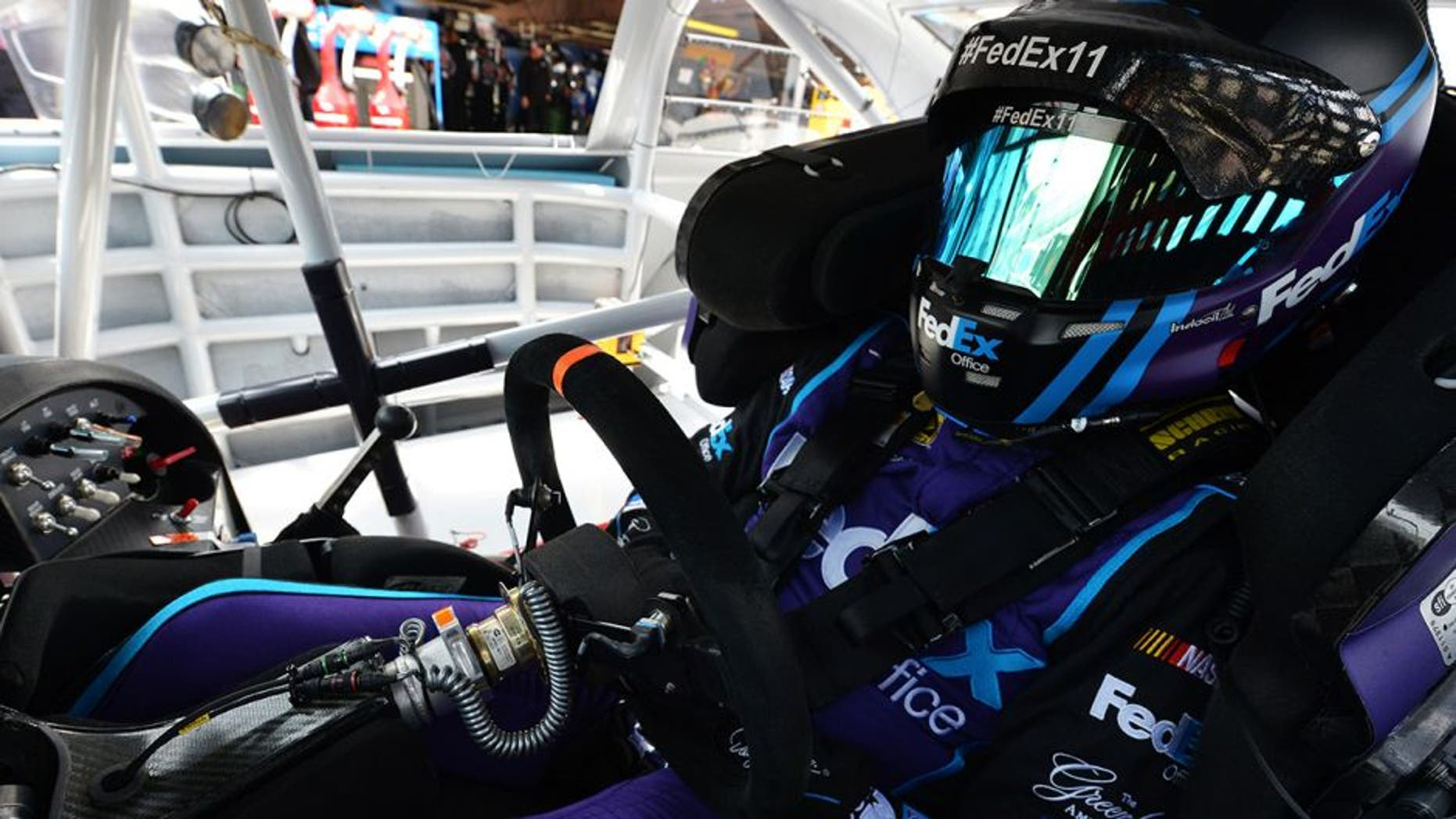 DOVER, DE - MAY 14: Denny Hamlin, driver of the #11 FedEx Office Toyota, sits in his car during practice for the NASCAR Sprint Cup AAA 400 Drive For Autism at Dover International Speedway on May 14, 2016 in Dover, Delaware. (Photo by Drew Hallowell/NASCAR via Getty Images)