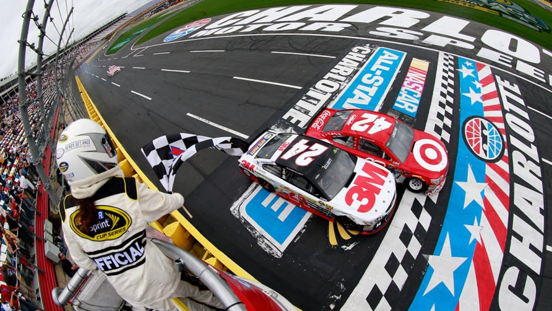 CHARLOTTE, NC - MAY 21: Kyle Larson, driver of the #42 Target Chevrolet, takes the checkered flag against Chase Elliott, driver of the #24 3M Chevrolet, to win the third segment of the NASCAR Sprint Cup Series Sprint Showdown at Charlotte Motor Speedway on May 21, 2016 in Charlotte, North Carolina. (Photo by Matt Sullivan/NASCAR via Getty Images)