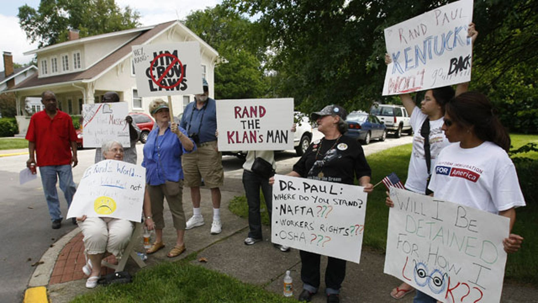 May 22: Demonstrators hold signs across the street from a Republican party unity rally in Frankfort, Ky.