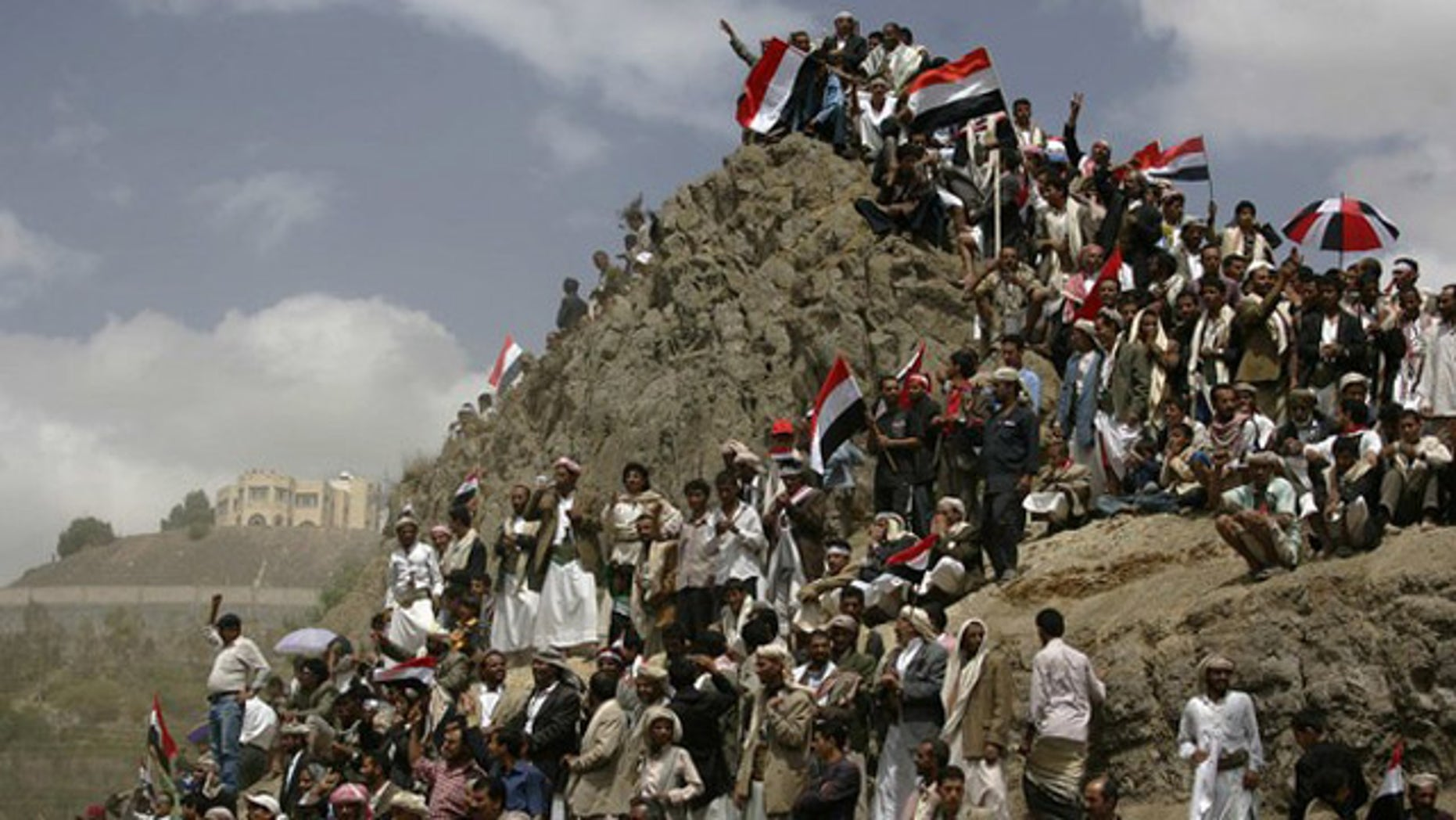 May 22: Anti-government protesters gather on a hillside to watch a ceremony commemorating the anniversary of Yemen's reunification in Sanaa (Reuters).