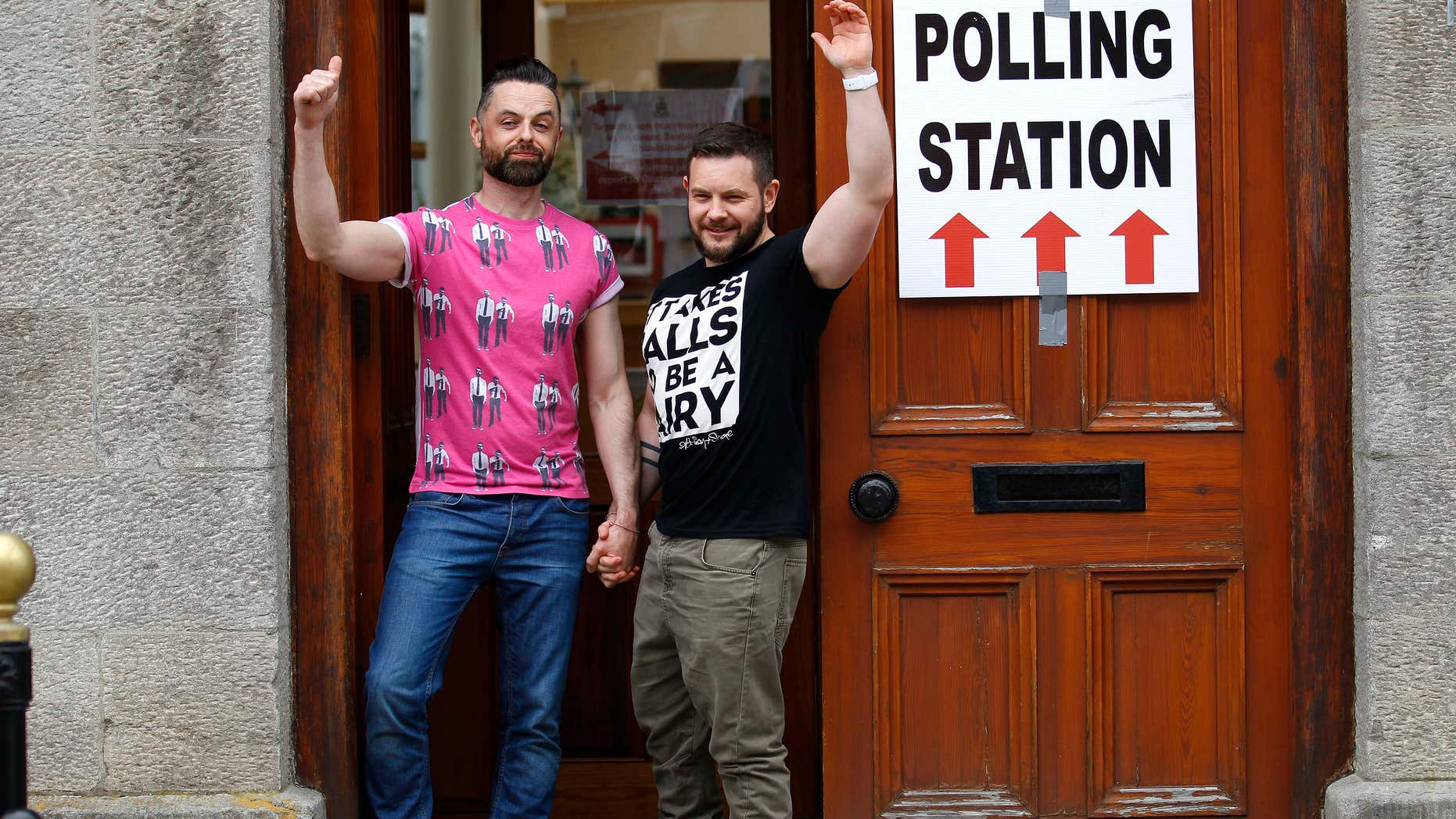 May 22, 2015: Partners Adrian, left and Shane, arrive to cast their vote at a polling station in Drogheda, Ireland.