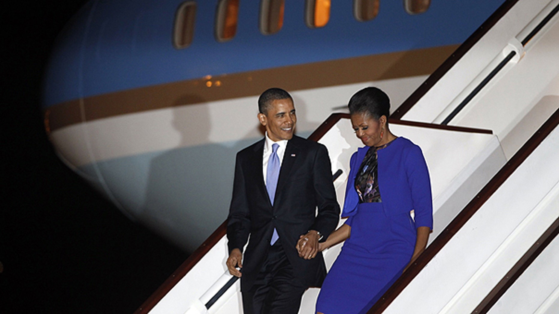 May 23: President Barack Obama and first lady Michelle Obama step off Air Force One as they arrive at London's Stansted Airport.