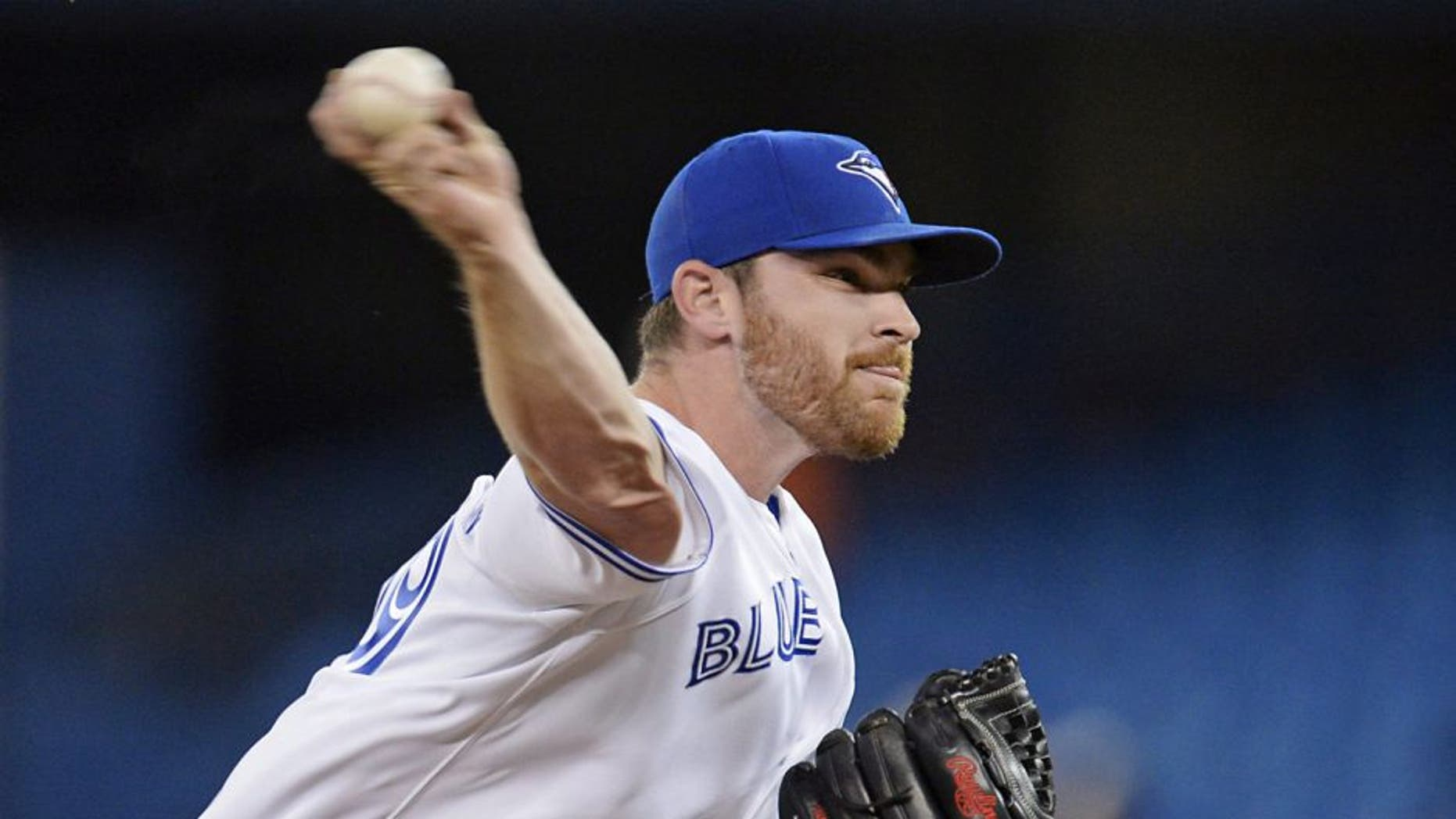 Toronto Blue Jays starting pitcher Liam Hendriks throws against the Oakland Athletics during the first inning of a baseball game Friday, May 23, 2014, in Toronto. (AP Photo/The Canadian Press, Frank Gunn)