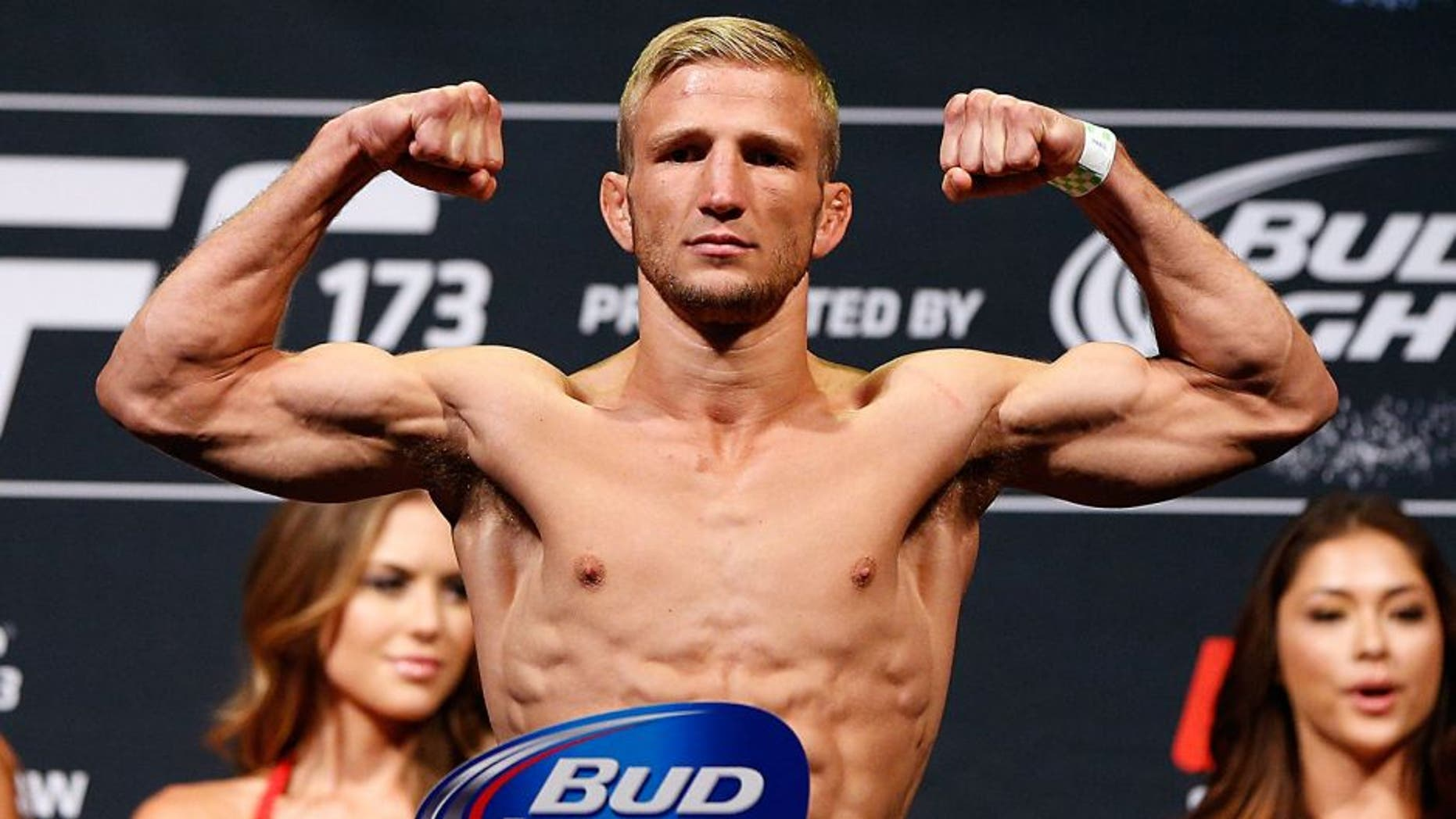 LAS VEGAS, NV - MAY 23: UFC bantamweight title challenger T.J. Dillashaw weighs in during the UFC 173 weigh-in at the MGM Grand Garden Arenaon May 23, 2014 in Las Vegas, Nevada. (Photo by Josh Hedges/Zuffa LLC/Zuffa LLC via Getty Images)
