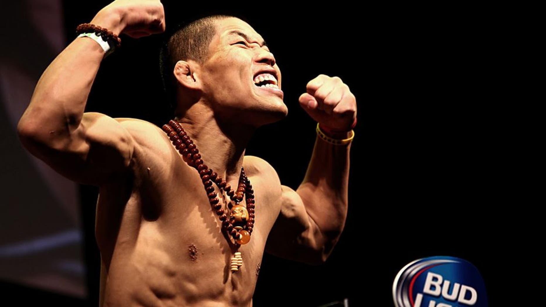 LAS VEGAS, NV - MAY 23: Li Jingliang of China steps on the scale during the UFC 173 weigh-in event at the MGM Grand Garden Arena on May 23, 2014 in Las Vegas, Nevada. (Photo by Brandon Magnus/Zuffa LLC/Zuffa LLC via Getty Images)