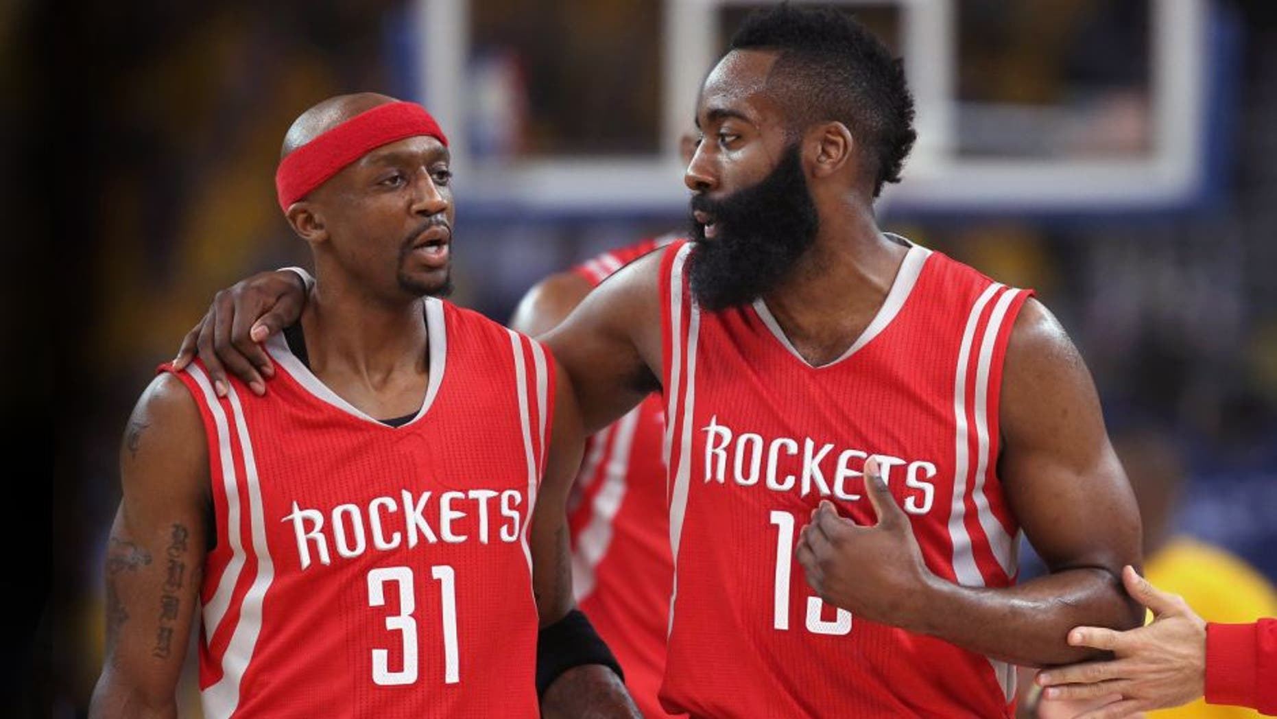 OAKLAND, CA - MAY 21: Jason Terry #31 and James Harden #13 of the Houston Rockets react after a play in the first quarter against the Golden State Warriors during game two of the Western Conference Finals of the 2015 NBA PLayoffs at ORACLE Arena on May 21, 2015 in Oakland, California. NOTE TO USER: User expressly acknowledges and agrees that, by downloading and or using this photograph, user is consenting to the terms and conditions of Getty Images License Agreement. (Photo by Ezra Shaw/Getty Images)
