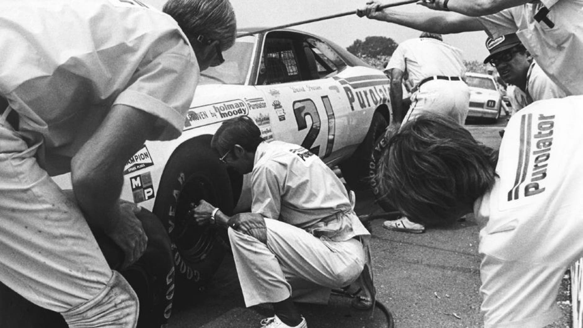 UNKNOWN — 1973: The Wood Brothers pit their car for driver David Pearson during a NASCAR Cup race. The team had an incredible year, winning 11 of the 18 races they entered, and starting from the pole position eight times. (Photo by ISC Images & Archives via Getty Images)
