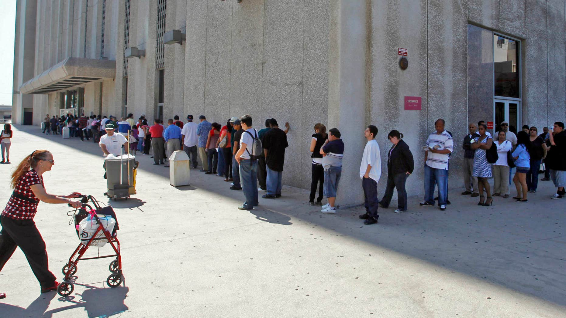 March 18, 2010: People line up outside the Metropolitan Courthouse, which handles traffic citations and other matters, in downtown Los Angeles.