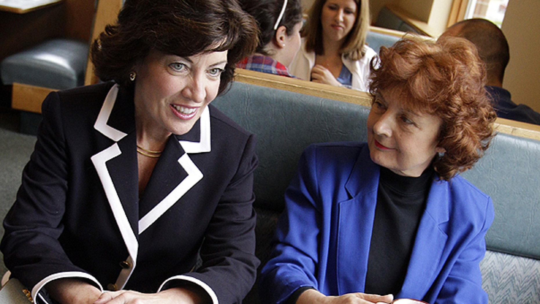 May 24: Democratic candidate for the 26th District Congressional seat, Kathy Hochul, left, talks with Debra Norton, right, and her husband Morrie Newman during a campaign stop at a restaurant in Amherst, N.Y.