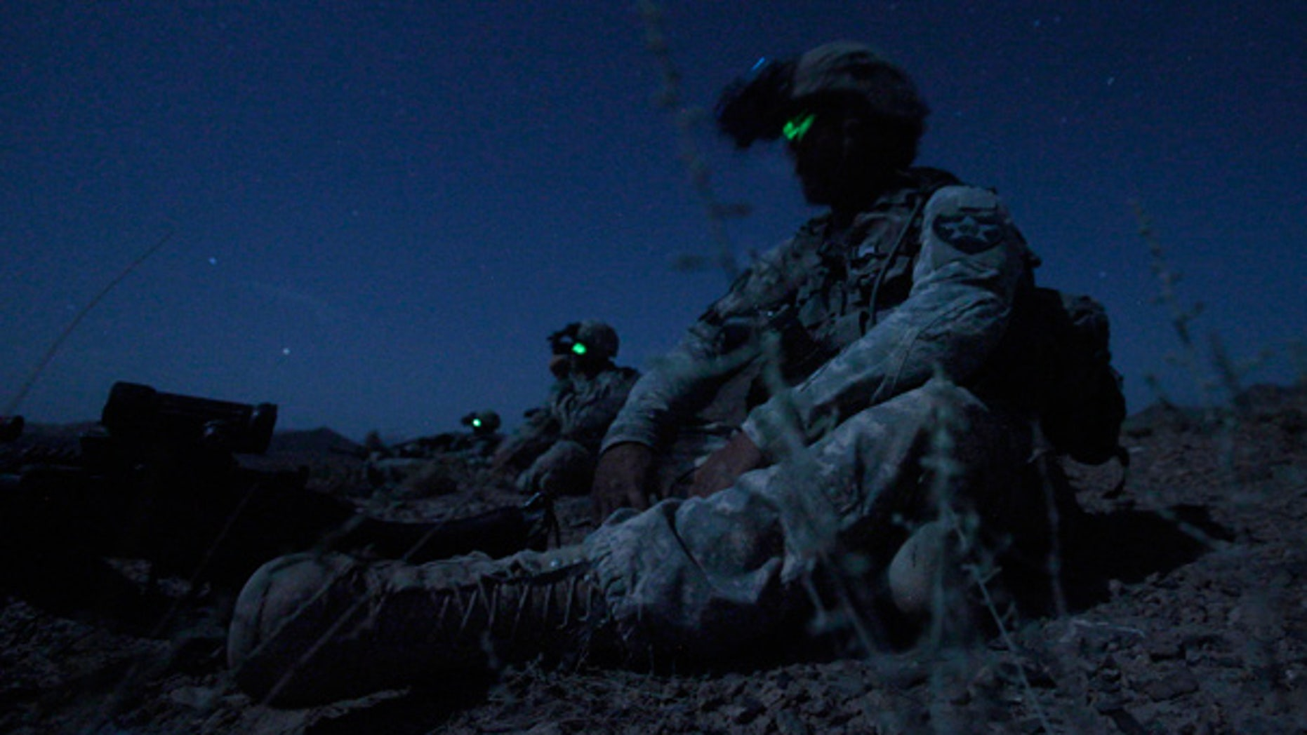 May 21: U.S. forces sit in the darkness during an ambush on Taliban fighters in Afghanistan's Kandahar province.
