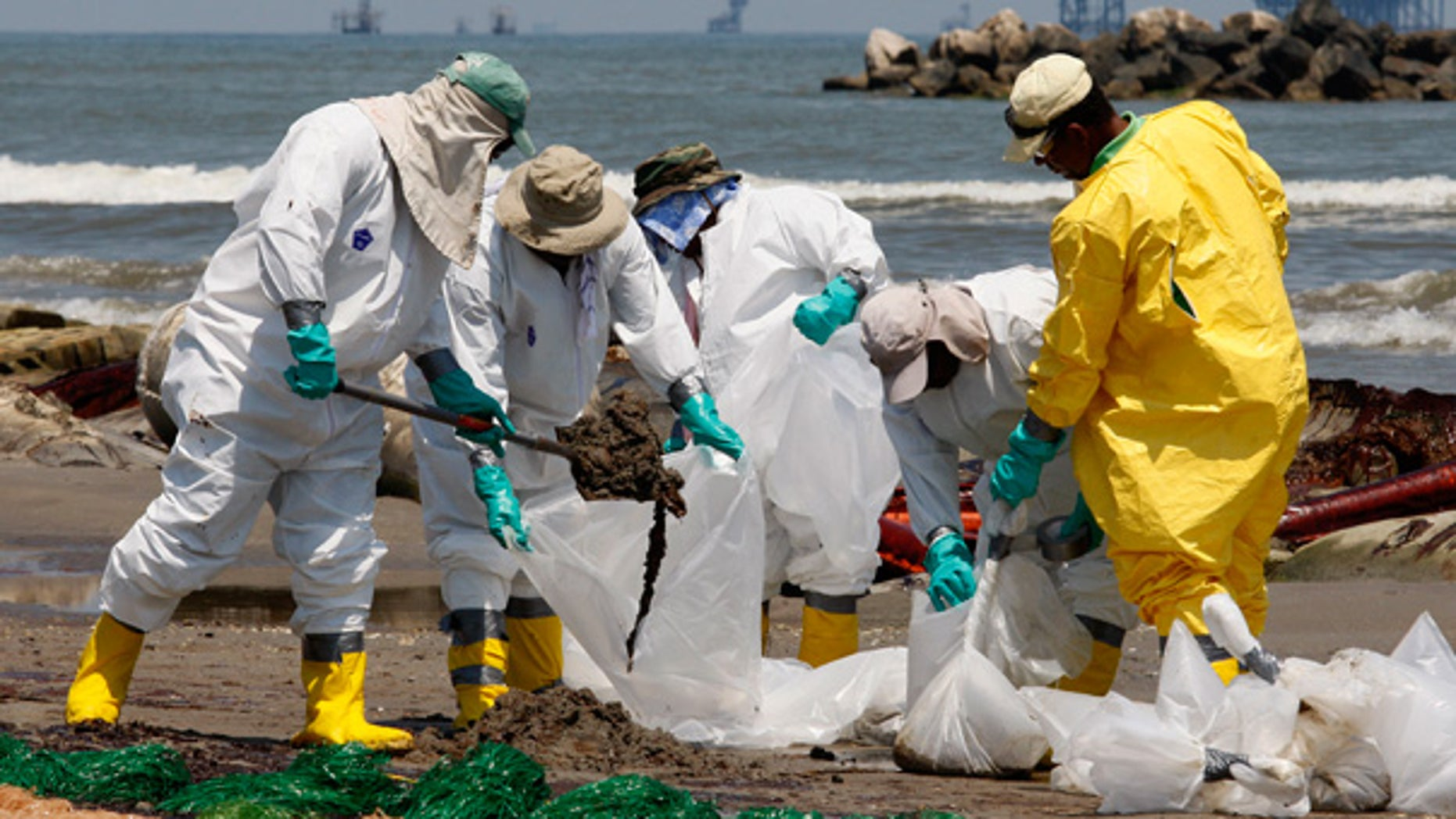 May 24: Workers shovel oil from the Deepwater Horizon spill off Fourchon Beach in Port Fourchon, La.