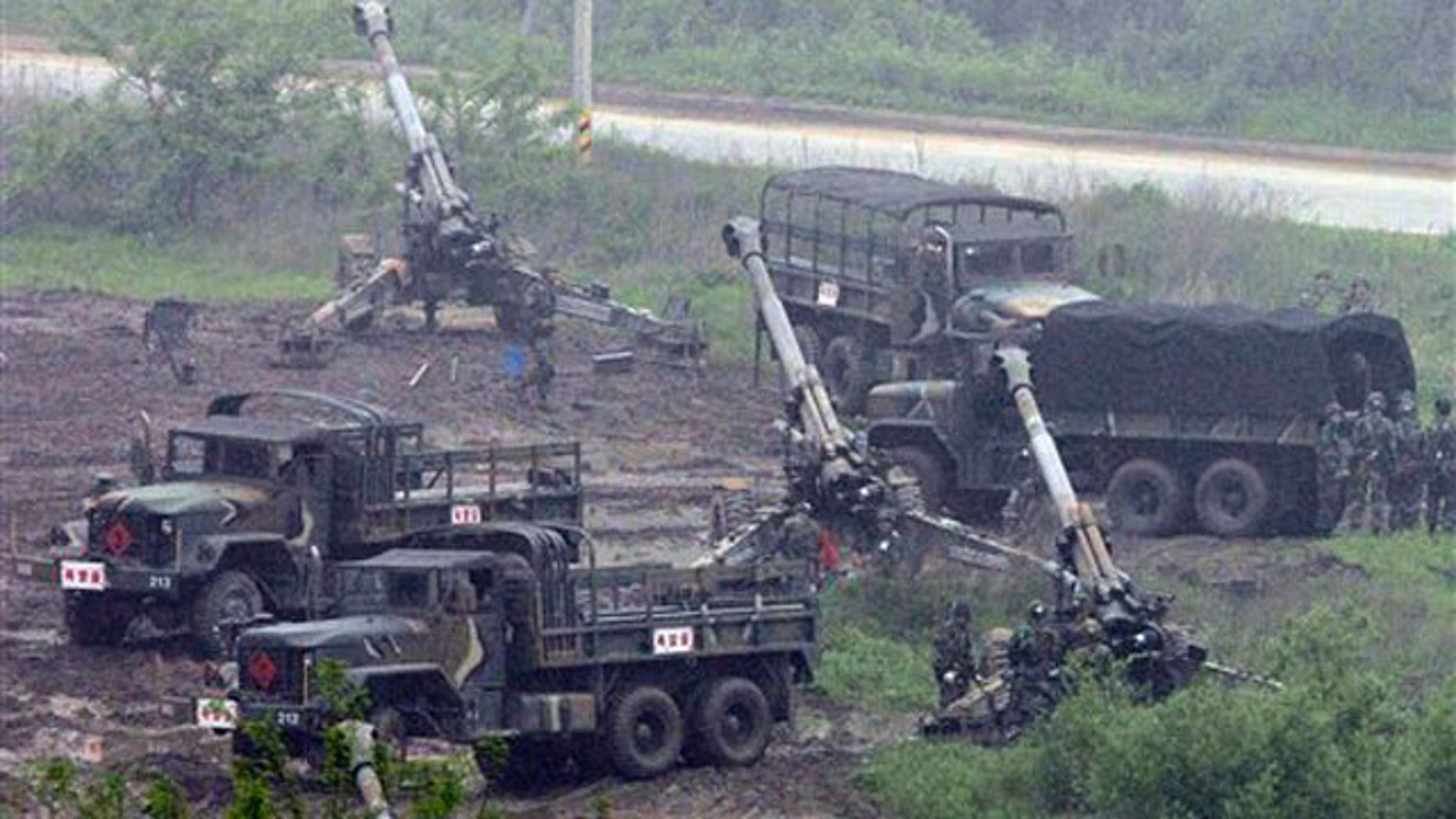 May 25: South Korean artillery soldiers take positions during an exercise against possible North Korean attacks, in Paju, north of Seoul.
