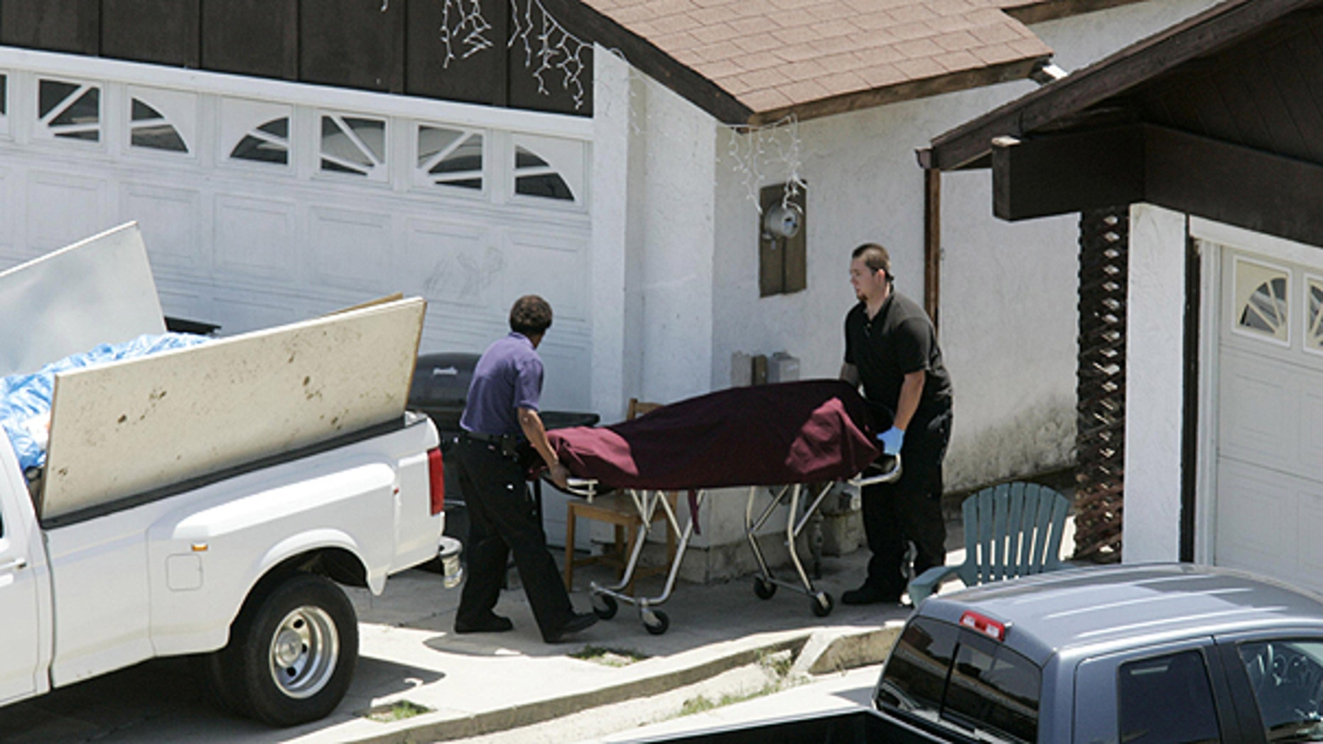 May 24: The body of an apparent drowning victim is removed at a house on the cul-de-sac of Parkcreek Court at North Bay Terraces, in San Diego.