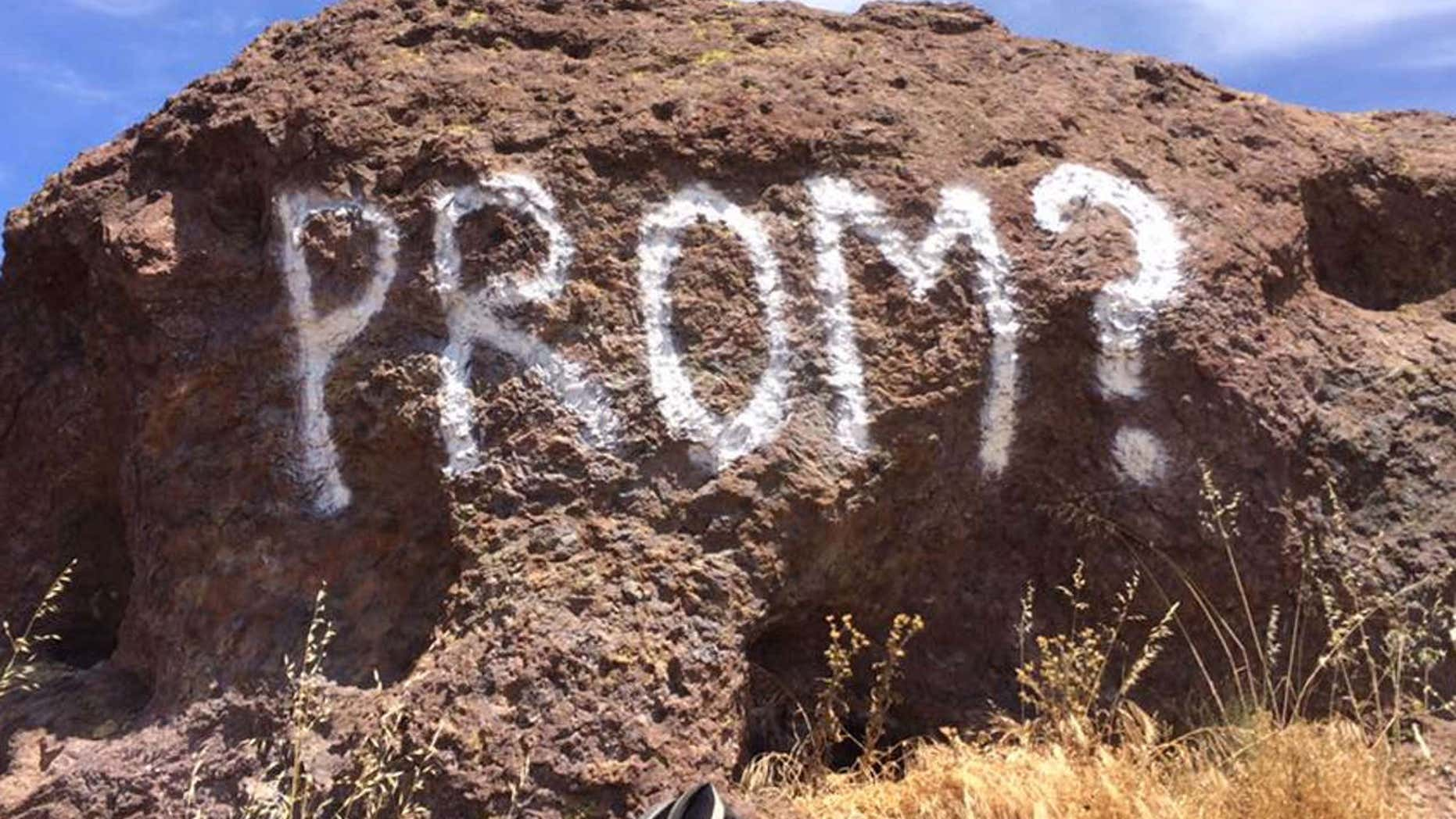 "Park rangers in Southern California are looking for the vandal who scrawled an apparent ""promposal"" across a red rock in the mountains."