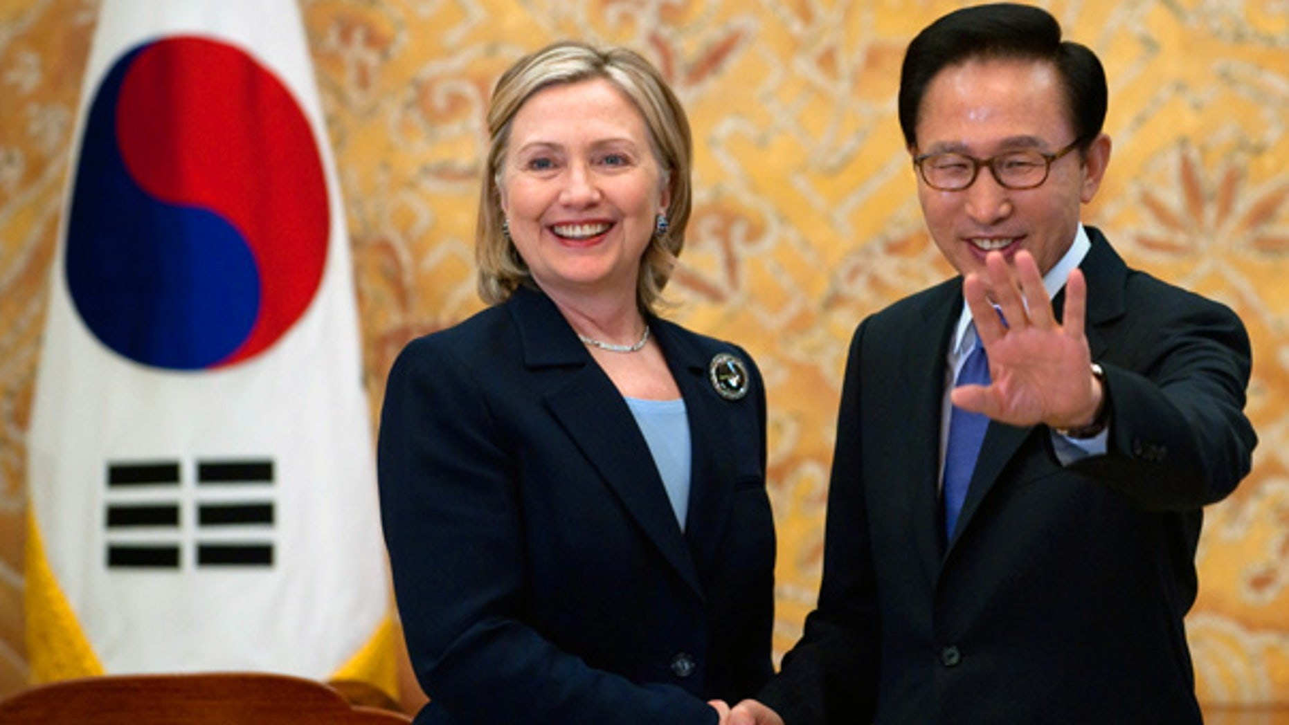 May 26: South Korean President Lee Myung-bak, right, shakes hands with U.S. Secretary of State Hillary Rodham Clinton during their meeting at the Presidential Blue House in Seoul, South Korea.