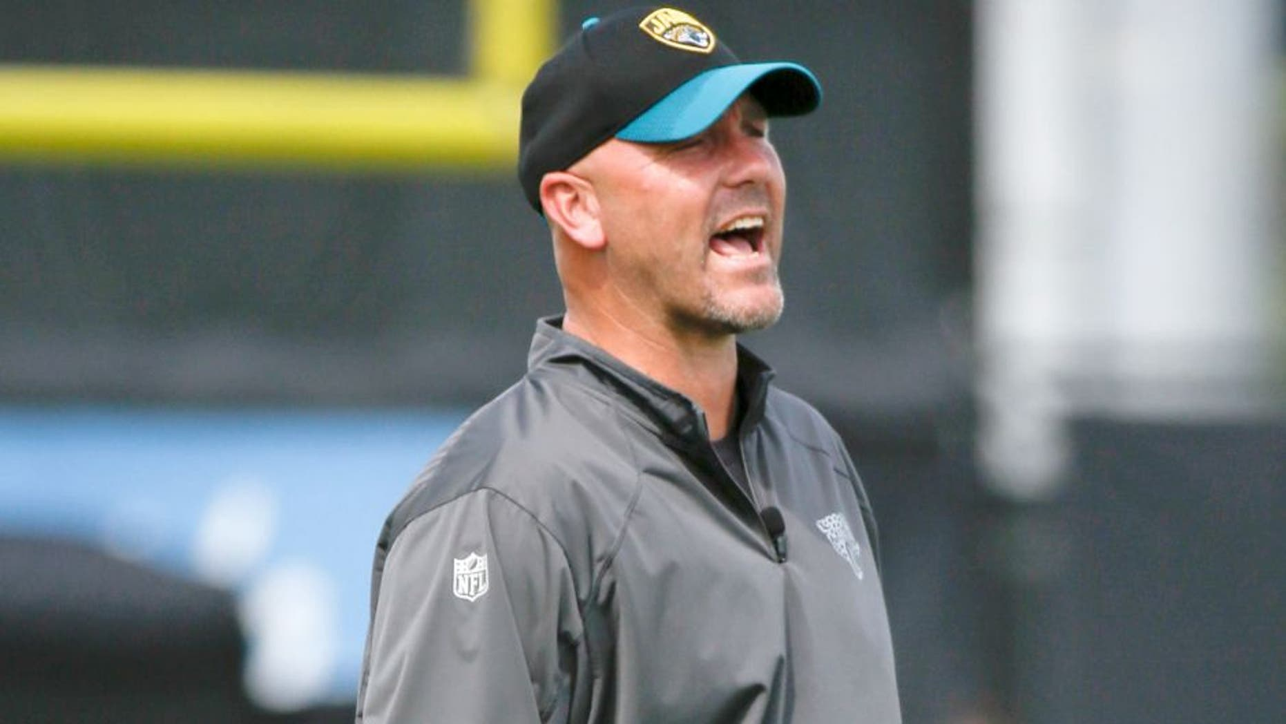 Jacksonville Jaguars head coach Gus Bradley shouts instructions to players during NFL football organized training activities, Tuesday, May 26, 2015, in Jacksonville, Fla. (AP Photo/John Raoux)
