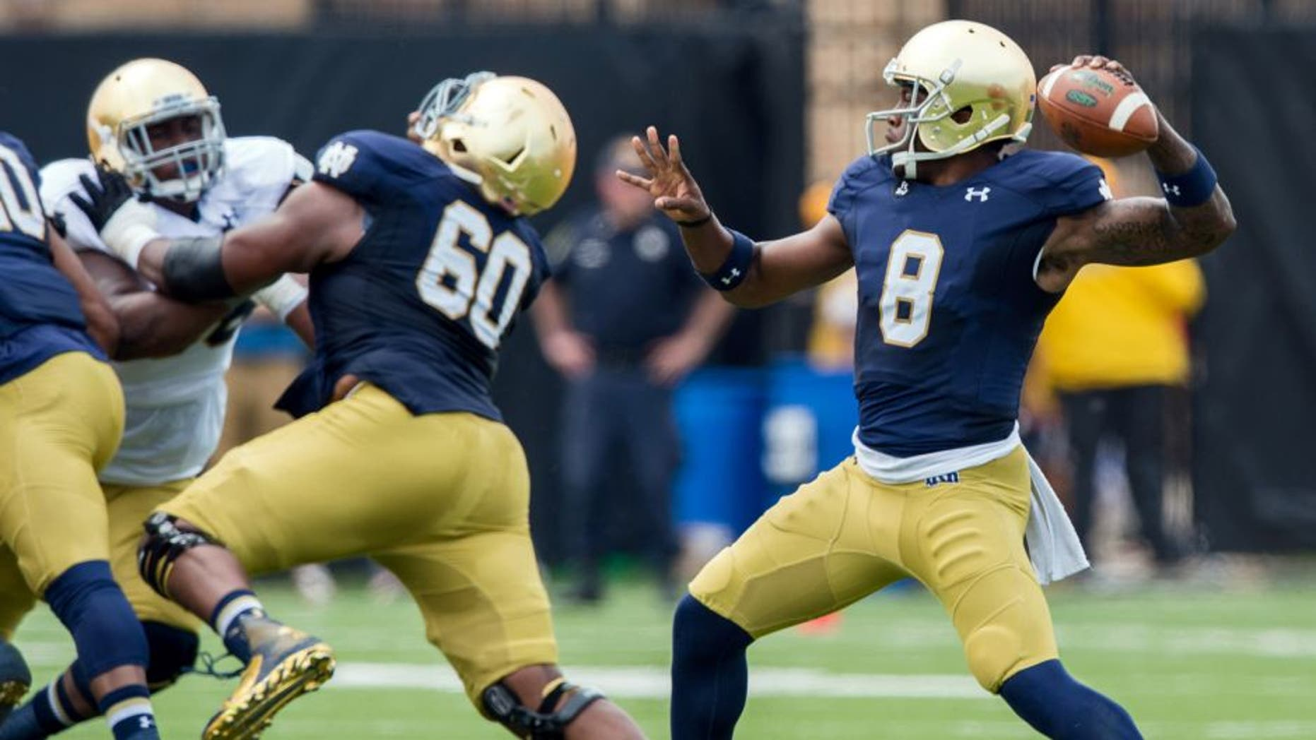 Apr 18, 2015; Notre Dame, IN, USA; Notre Dame Fighting Irish quarterback Malik Zaire (8) throws in the first quarter of the Blue-Gold Game at the LaBar Practice Complex. Mandatory Credit: Matt Cashore-USA TODAY Sports