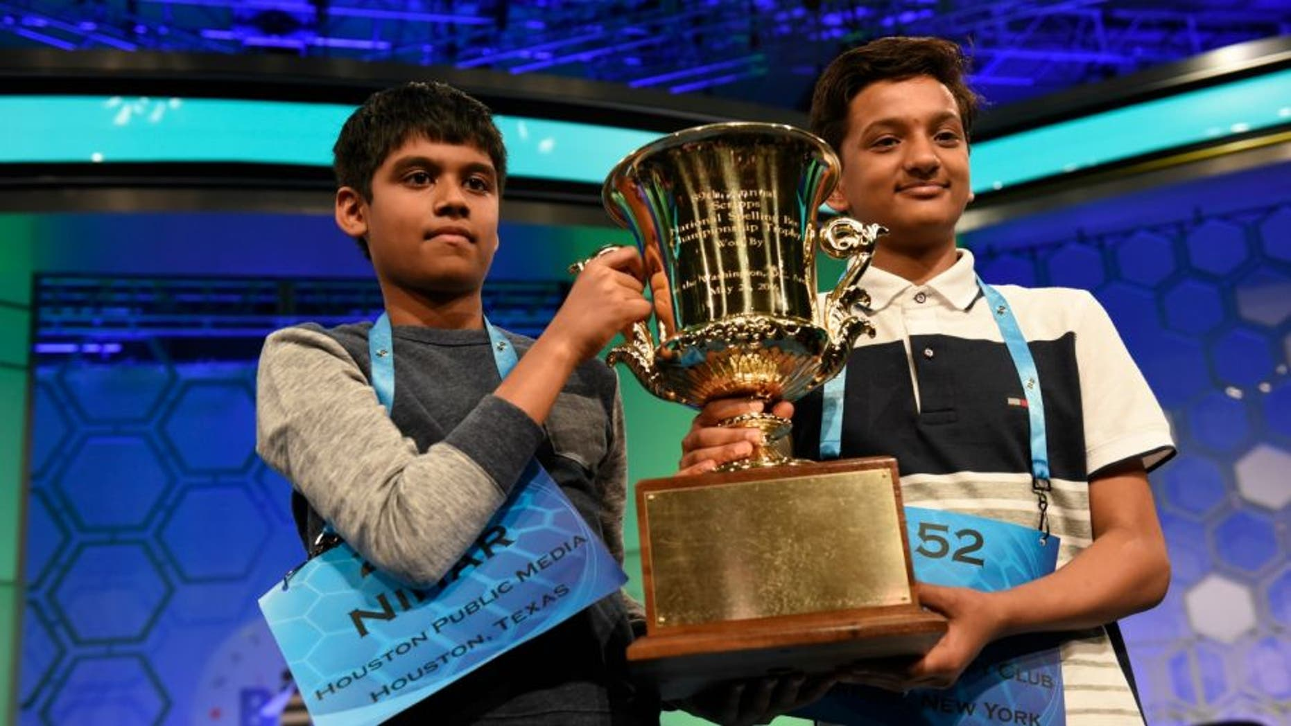 May 26, 2016; National Harbor, MD, USA; Nihar Janga, 11, of Austin, Texas (L) and Jairam Hathwar, 13, of Painted Post, N.Y. (R) celebrate as co-champions during the 2016 Scripps National Spelling Bee at the Gaylord National Resort and Convention Center.Mandatory Credit: Jack Gruber-USA TODAY NETWORK