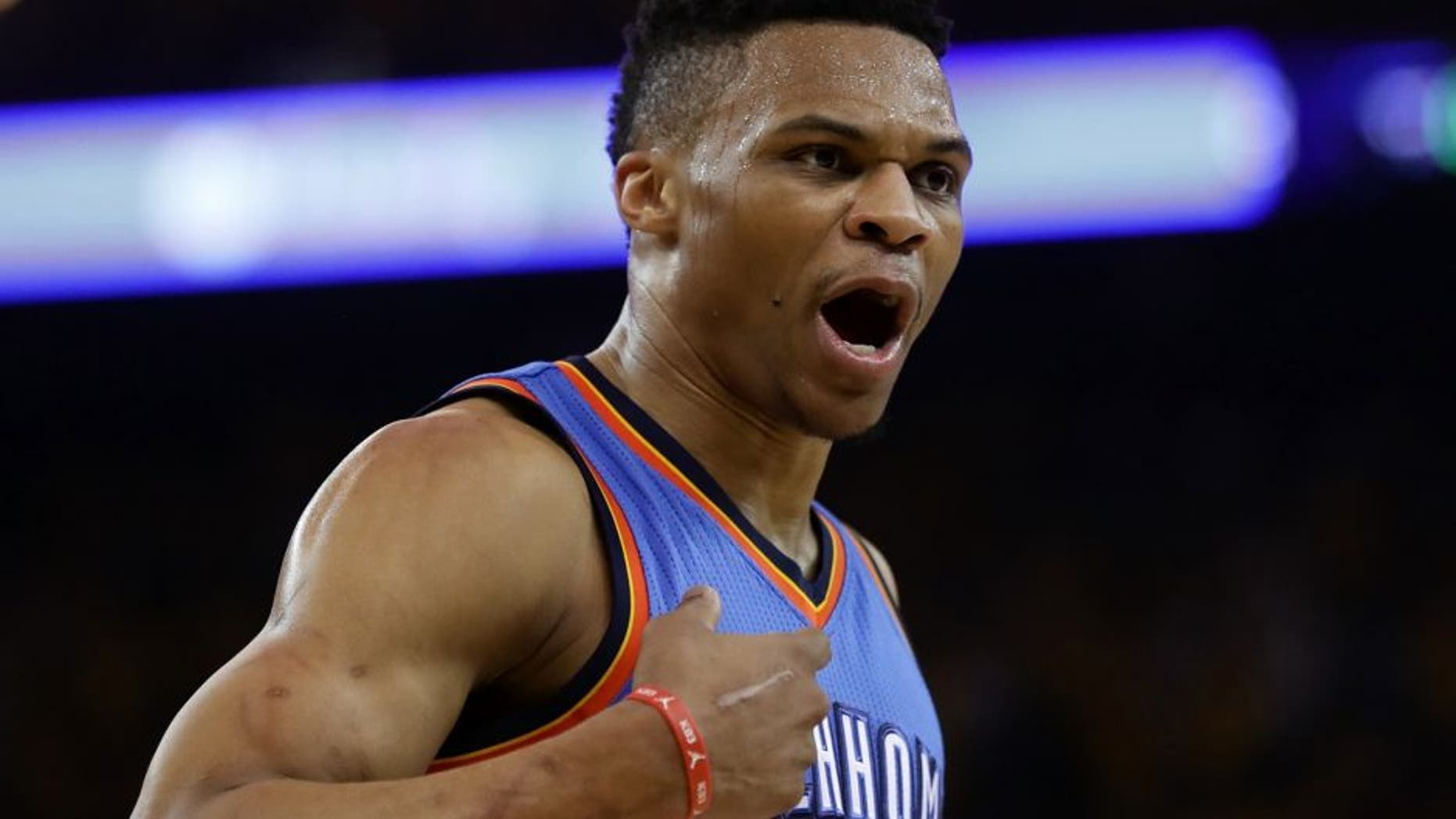 OAKLAND, CA - MAY 26: Russell Westbrook #0 of the Oklahoma City Thunder reacts to a play against the Golden State Warriors during Game Five of the Western Conference Finals during the 2016 NBA Playoffs at ORACLE Arena on May 26, 2016 in Oakland, California. (Photo by Ezra Shaw/Getty Images)